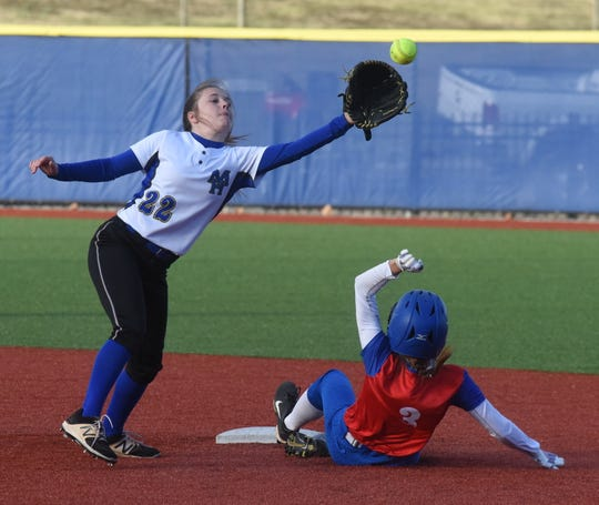 Mountain Home shortstop Mattie Belk reaches for a throw against Paragould on Thursday night.