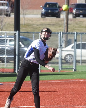 Mountain Home pitcher Lauren Loving throws to first base for an out during the Lady Bombers' 3-2 victory over Harrison on Friday evening.