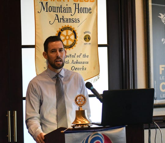 Plant Family Therapeutics co-owner Clint Mickle speaks to the Mountain Home Rotary Club on Thursday. PFT will be Baxter County's first medical marijuana dispensary when it opens in later summer.