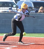 Mountain Home's Tori Robb puts down a bunt against Harrison on Friday.