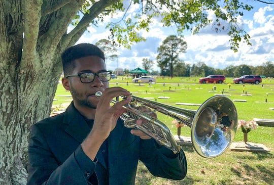 William Joiner of West Monroe, a member of Talons for Taps, performs taps at a funeral for a U.S. veteran. Under the direction of VAPA's Eric Siereveld, members of ULM's Trumpet Studio make up Talons for Taps. The trumpeters are available to play taps at the funerals of area veterans. There is no cost for the service.