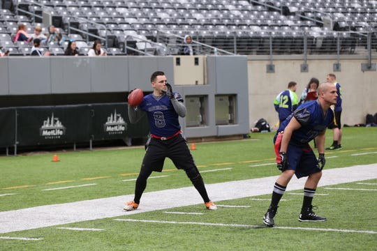 Manchester PBA Local 246 prepares to pass during the Special Olympics Snow Bowl at MetLife Stadium on Friday, March 15, 2019.