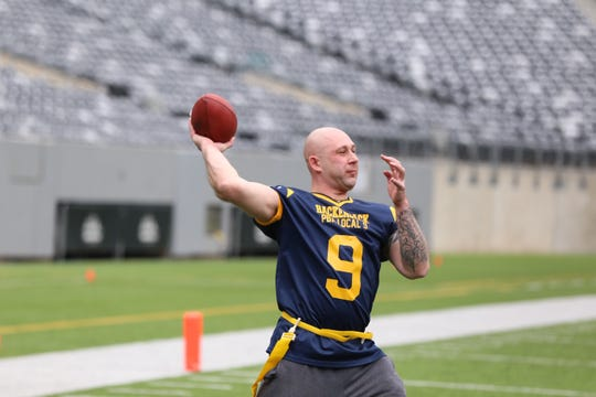 Hackensack PBA Local 9 goes back to pass during the Special Olympics Snow Bowl at MetLife Stadium on Friday, March 15, 2019.