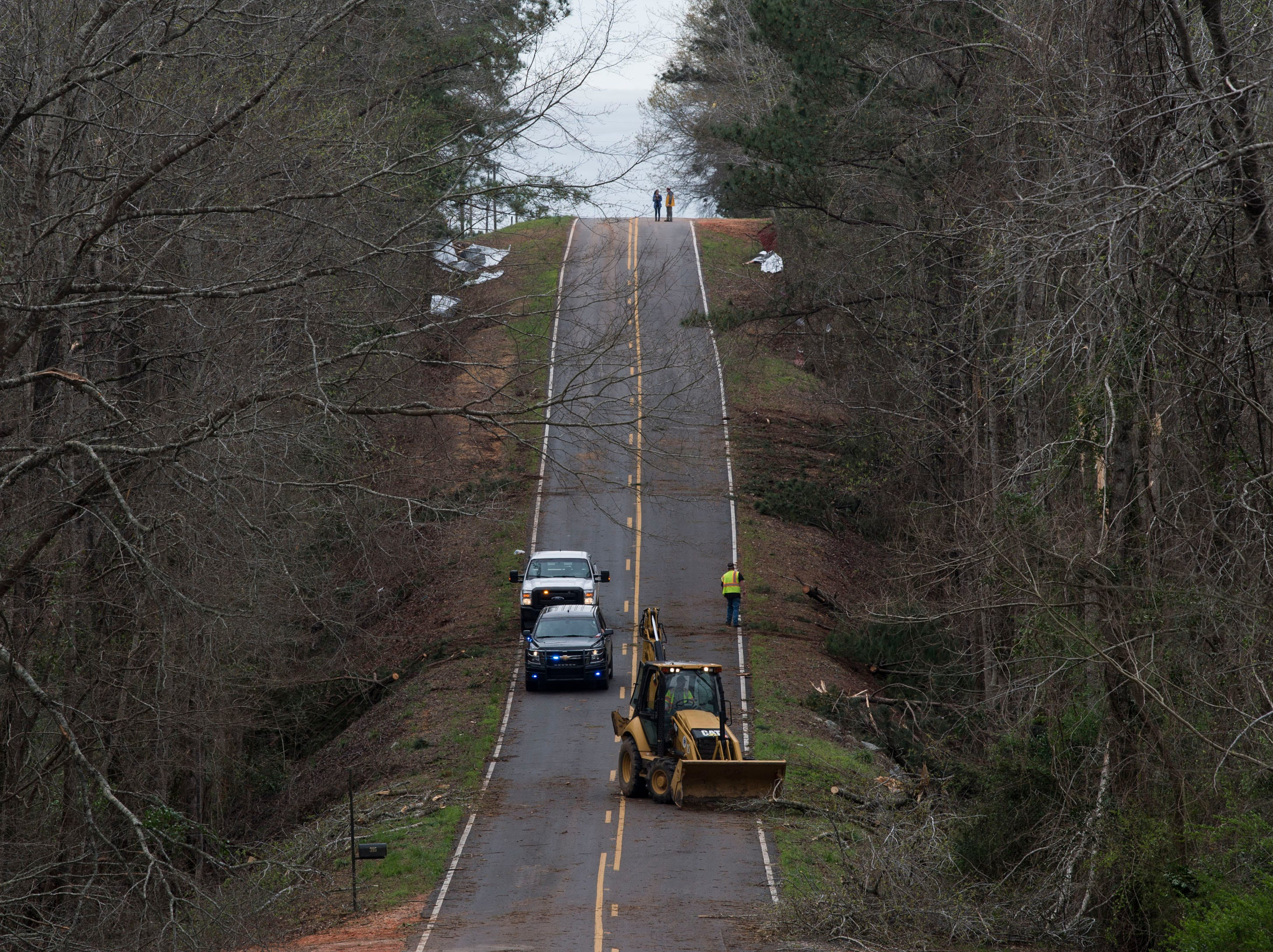 Crews work to clear the road after a possible Tornado struck in Titus, Ala., on Friday, March 15, 2019.