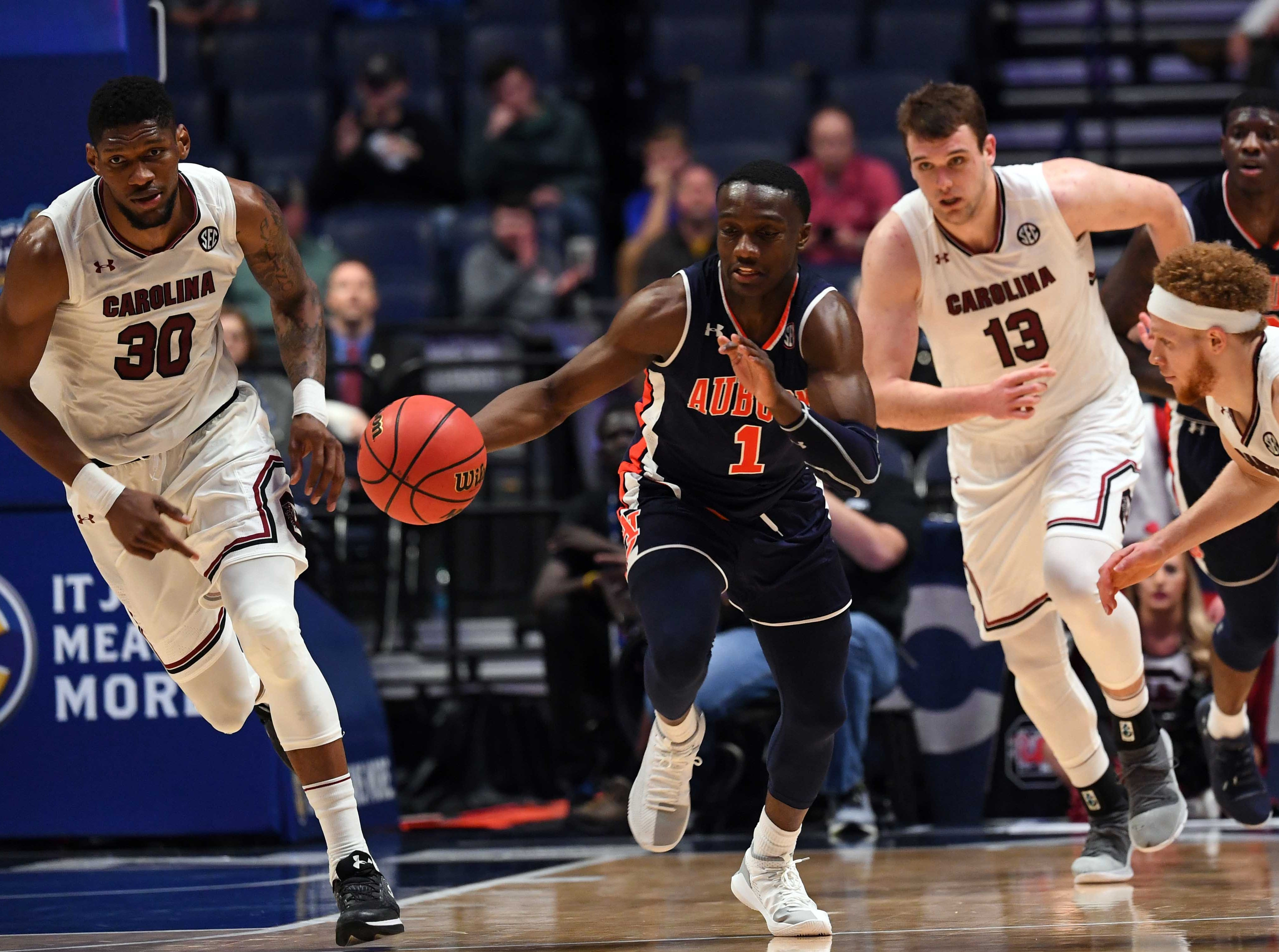 Mar 15, 2019; Nashville, TN, USA; Auburn Tigers guard Jared Harper (1) pushes the ball up the floor after stealing the ball from South Carolina Gamecocks guard Hassani Gravett (2) during the second half  of the SEC conference tournament at Bridgestone Arena. Mandatory Credit: Christopher Hanewinckel-USA TODAY Sports