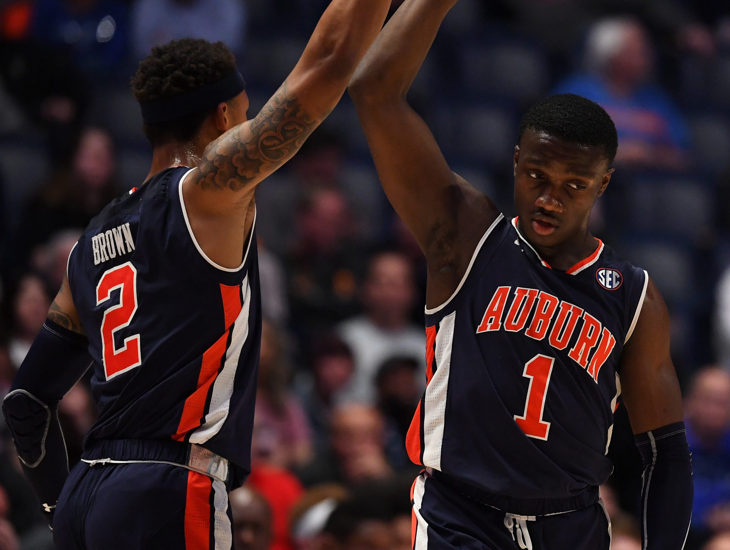 Mar 15, 2019; Nashville, TN, USA; Auburn Tigers guard Jared Harper (1) and Tigers guard Bryce Brown (2) celebrate after a basket against the South Carolina Gamecocks during the first half of the SEC conference tournament at Bridgestone Arena. Mandatory Credit: Christopher Hanewinckel-USA TODAY Sports