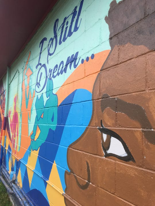 A mural stands outside That's My Dog Jr. in Montgomery.