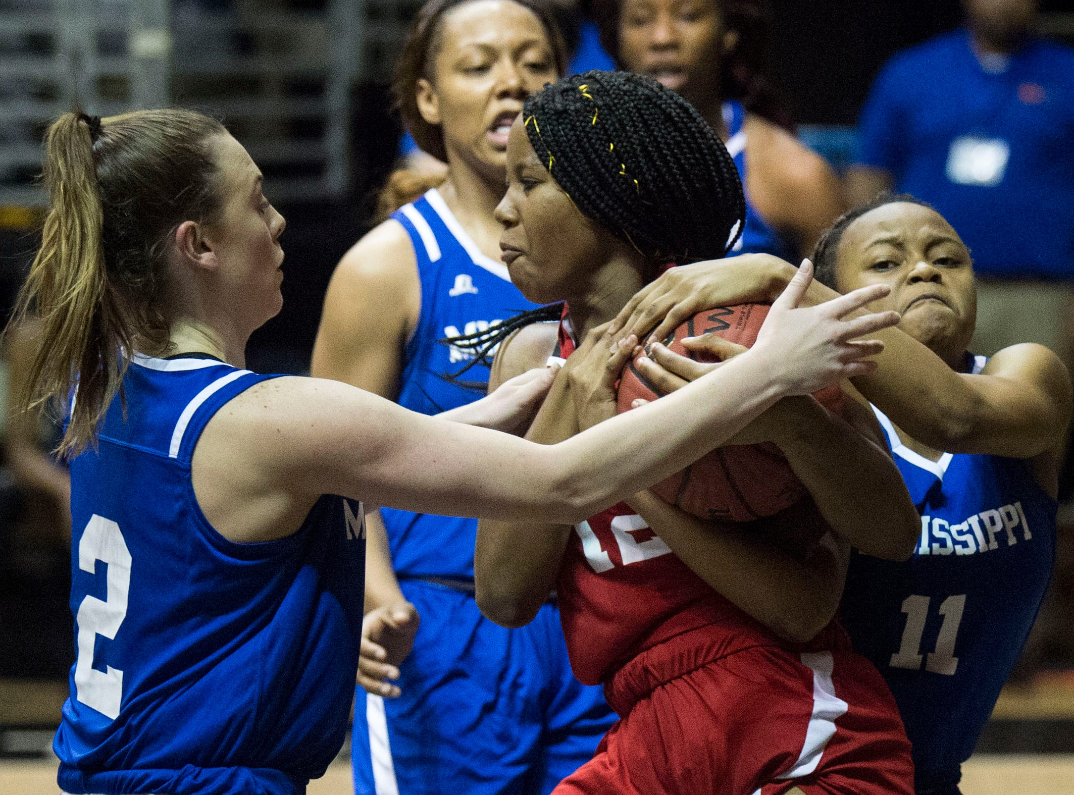 Alabama's Aniyah Smith (12) and Mississippi's Jalisa Outlaw (11) fight for a loose ball during the Alabama-Mississippi All-Star game at the Dunn-Oliver Acadome in Montgomery, Ala., on Friday, March 15, 2019. Alabama All-stars lead the Mississippi All-stars 48-34 at halftime.