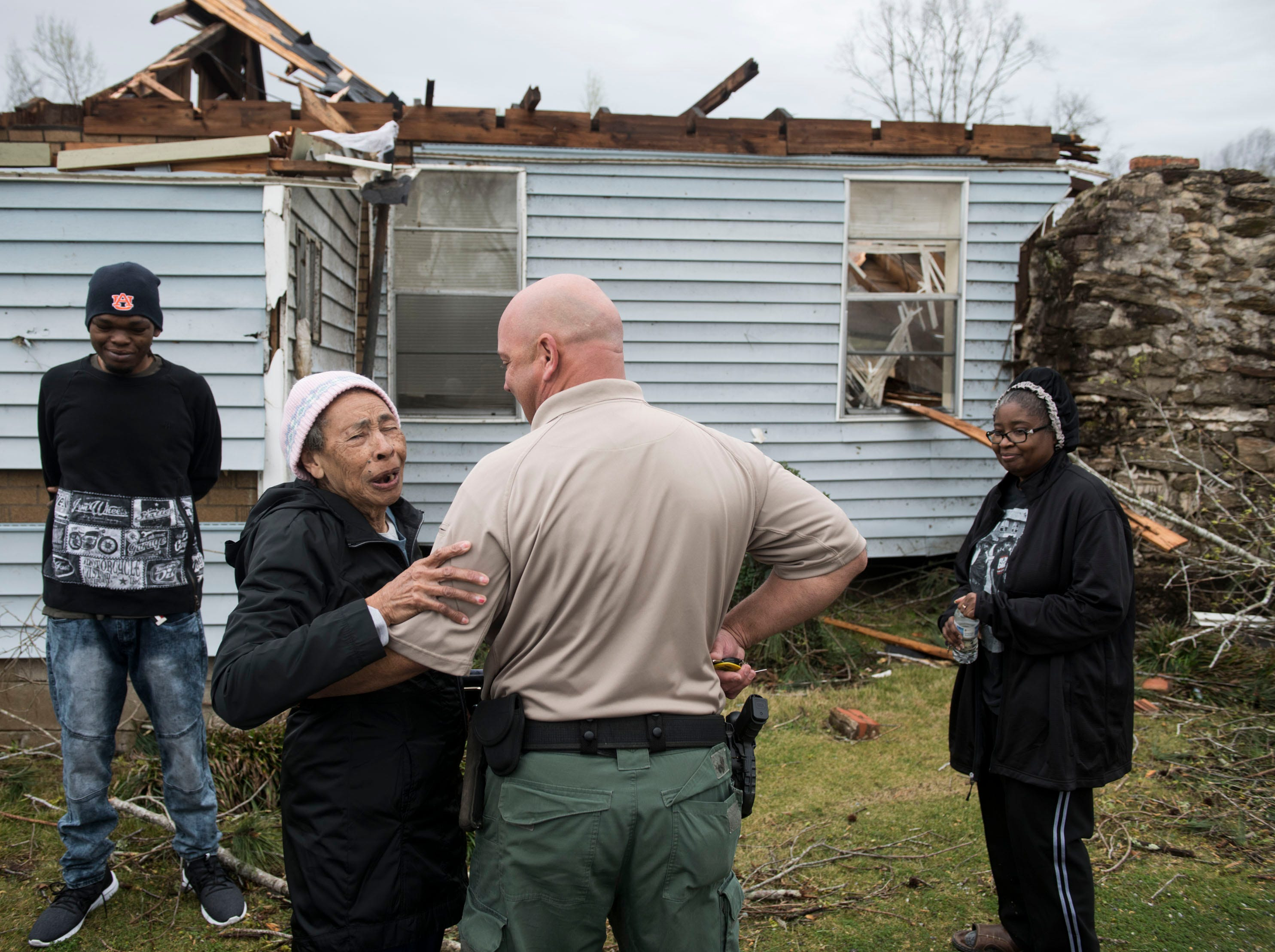Arcuqila Pearson, 87, talks with Grady Myers, of Alabama Wildlife and Fisheries, who rescued Pearson the night before after a tornado struck her house in Titus, Ala., on Friday, March 15, 2019.