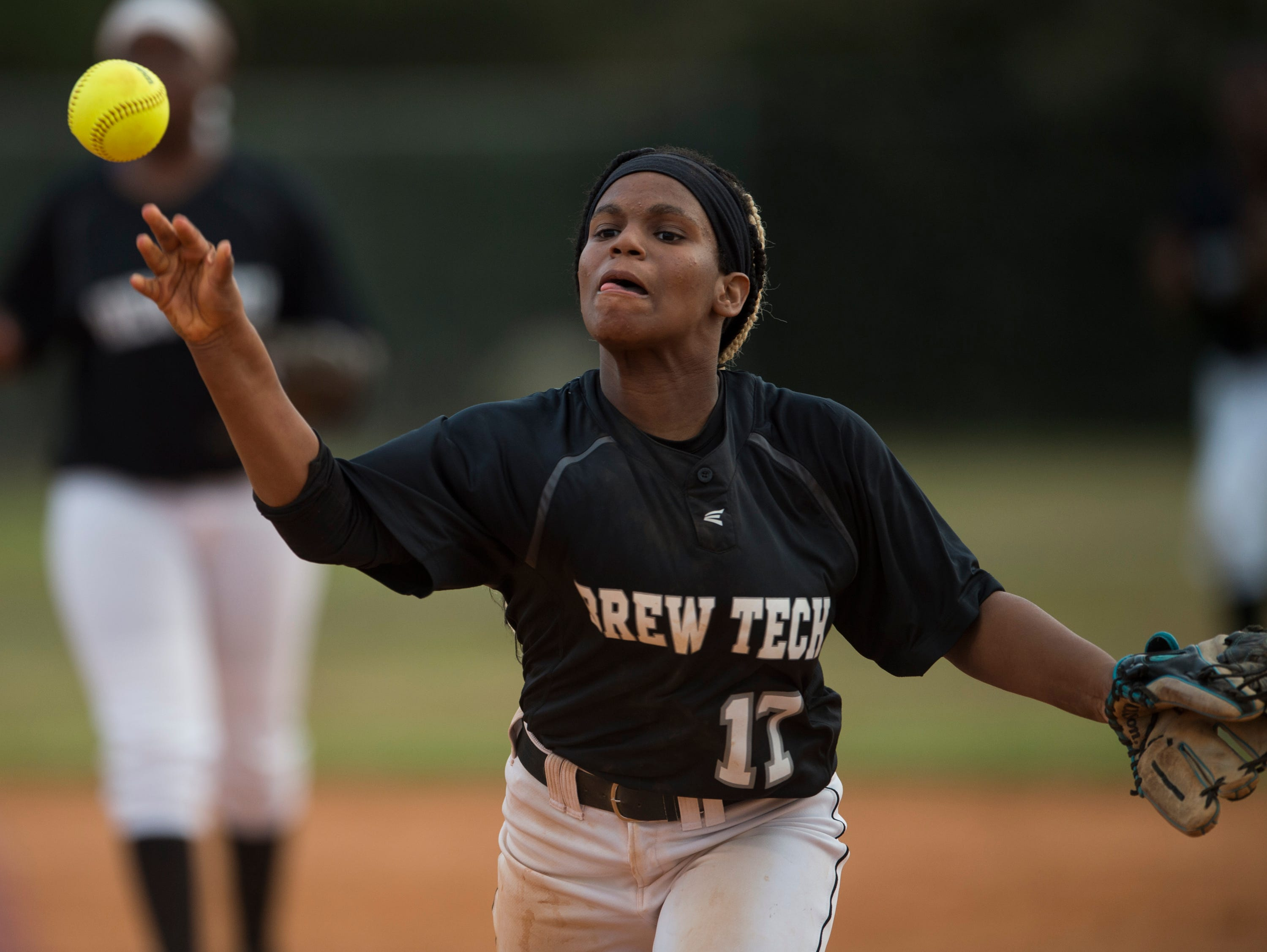 Brew Tech's Erica Ellis (17) throws to first base at Thompson Park in Montgomery, Ala., on Thursday, March 14, 2019. Tallassee defeated Brew Tech 7-0.