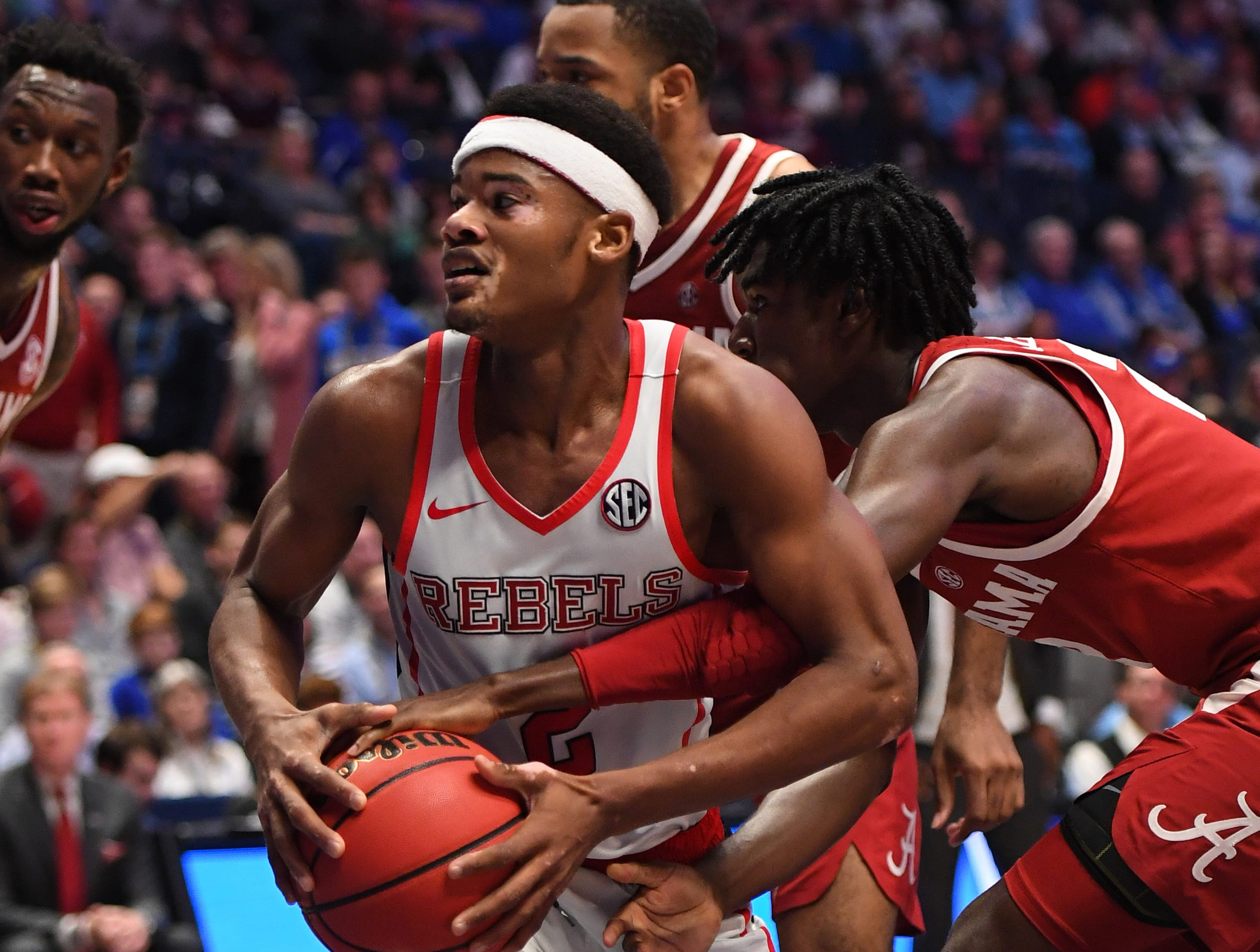 Mar 14, 2019; Nashville, TN, USA; Mississippi Rebels guard Devontae Shuler (2) after grabbing a rebound in the lane against the Alabama Crimson Tide during the first half of the SEC conference tournament at Bridgestone Arena. Mandatory Credit: Christopher Hanewinckel-USA TODAY Sports