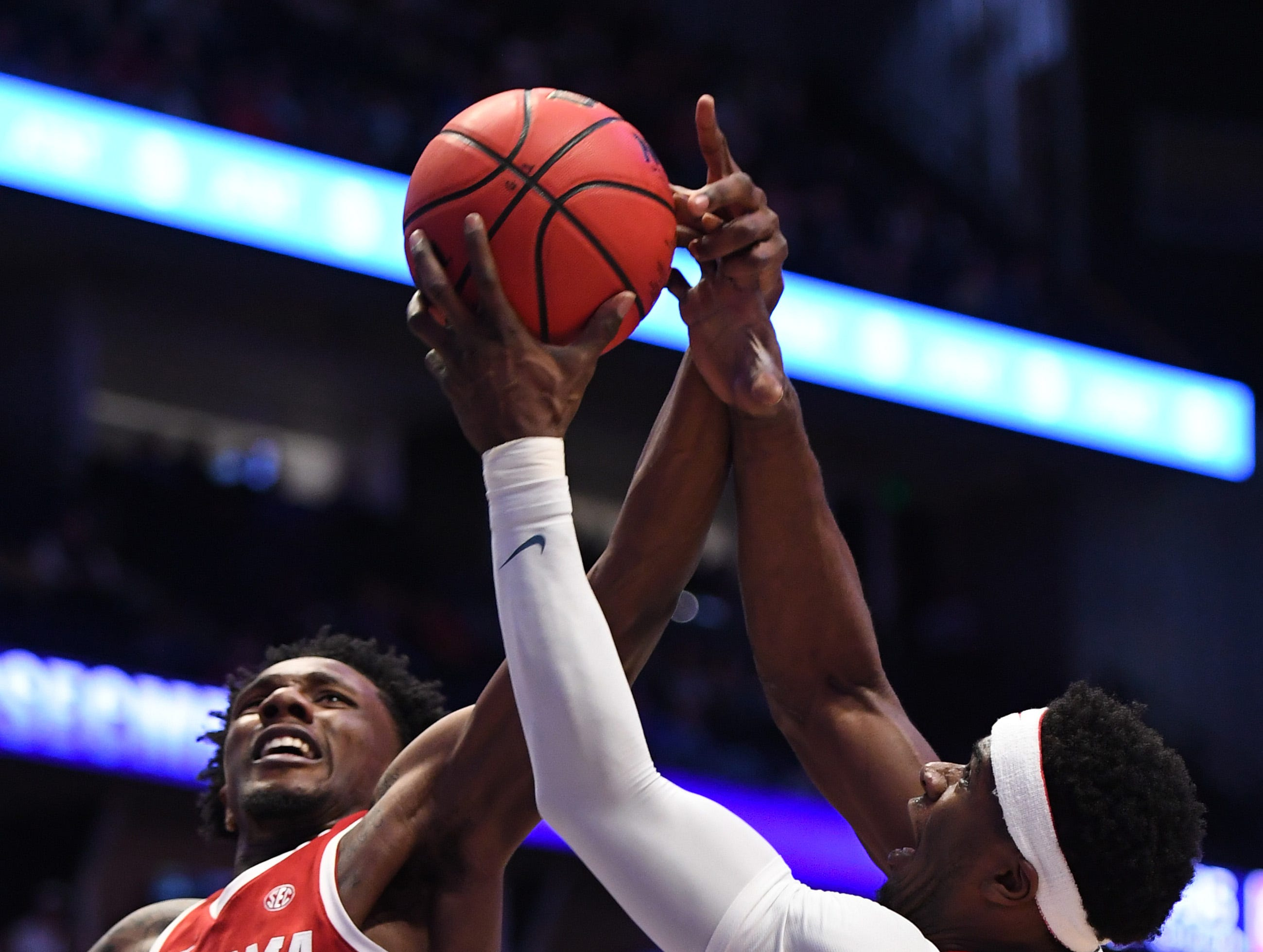 Mar 14, 2019; Nashville, TN, USA; Alabama Crimson Tide guard Tevin Mack (34) works for a rebound against Mississippi Rebels guard Terence Davis (3) during the first half of the SEC conference tournament at Bridgestone Arena. Mandatory Credit: Christopher Hanewinckel-USA TODAY Sports