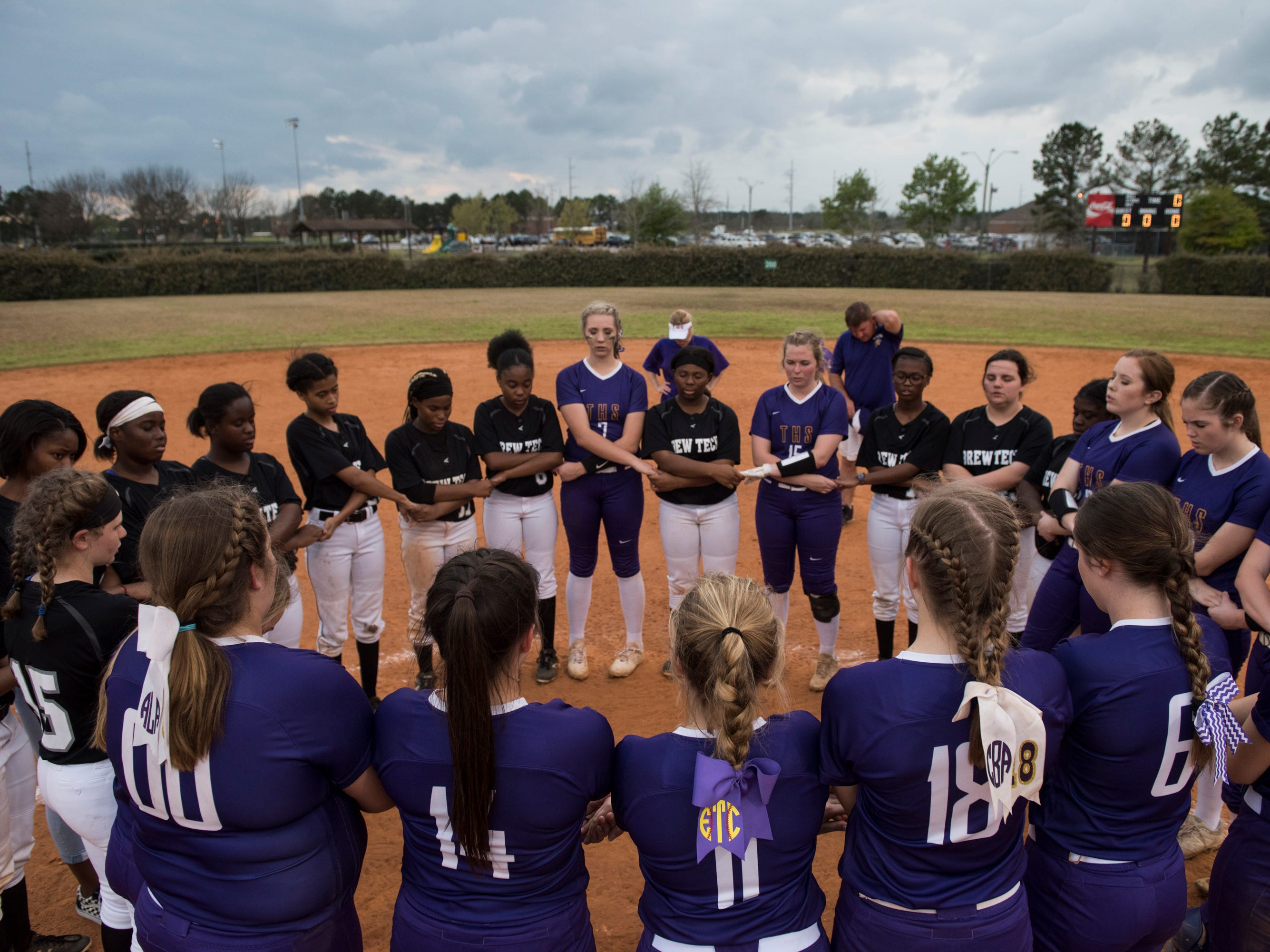 Brew Tech and Tallassee pray together after the game at Thompson Park in Montgomery, Ala., on Thursday, March 14, 2019. Tallassee defeated Brew Tech 7-0.