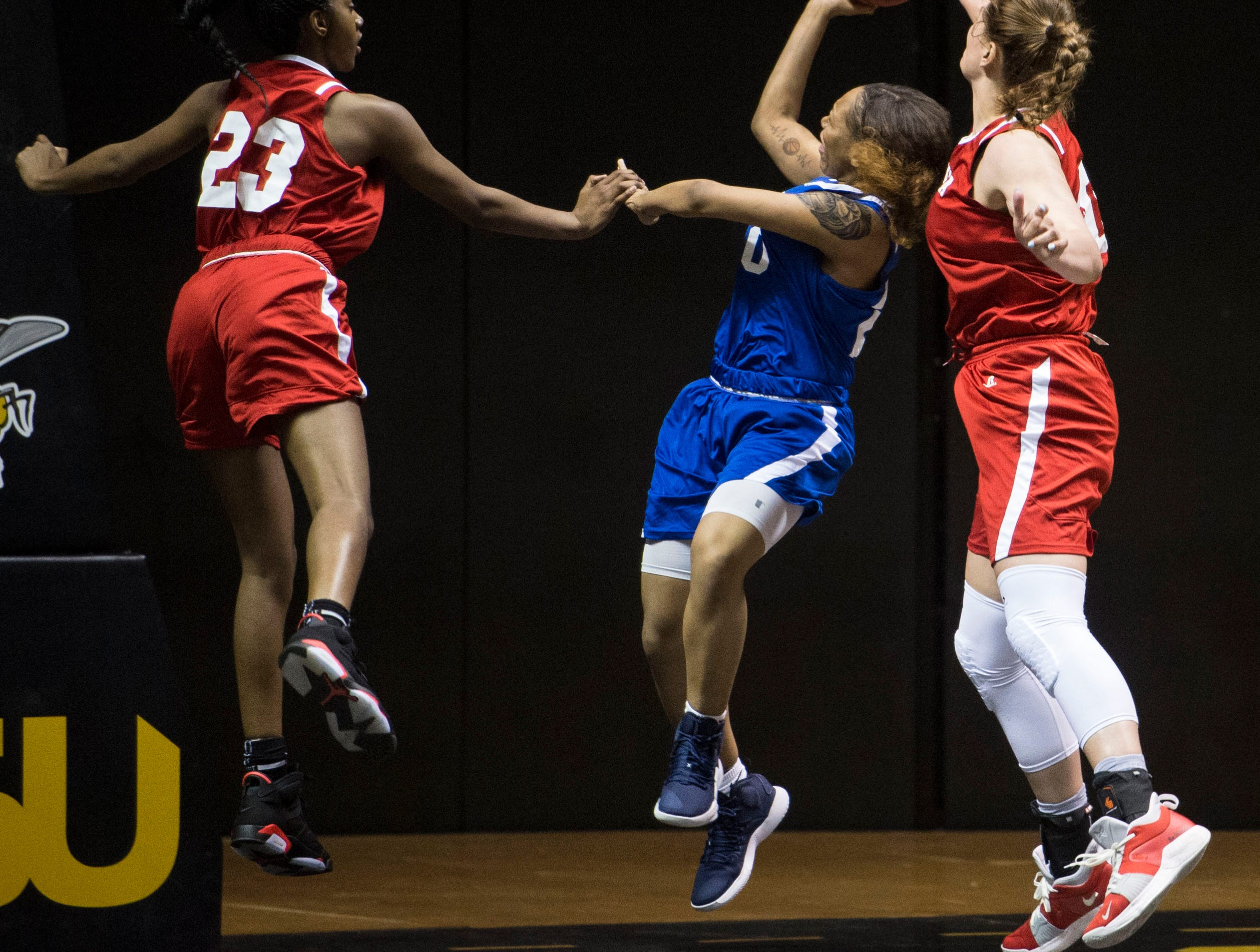 Mississippi's Jayla Alexander (20) is blocked by Alabama's River Baldwin (30) as she goes up for a layup during the Alabama-Mississippi All-Star game at the Dunn-Oliver Acadome in Montgomery, Ala., on Friday, March 15, 2019. Alabama All-stars lead the Mississippi All-stars 48-34 at halftime.