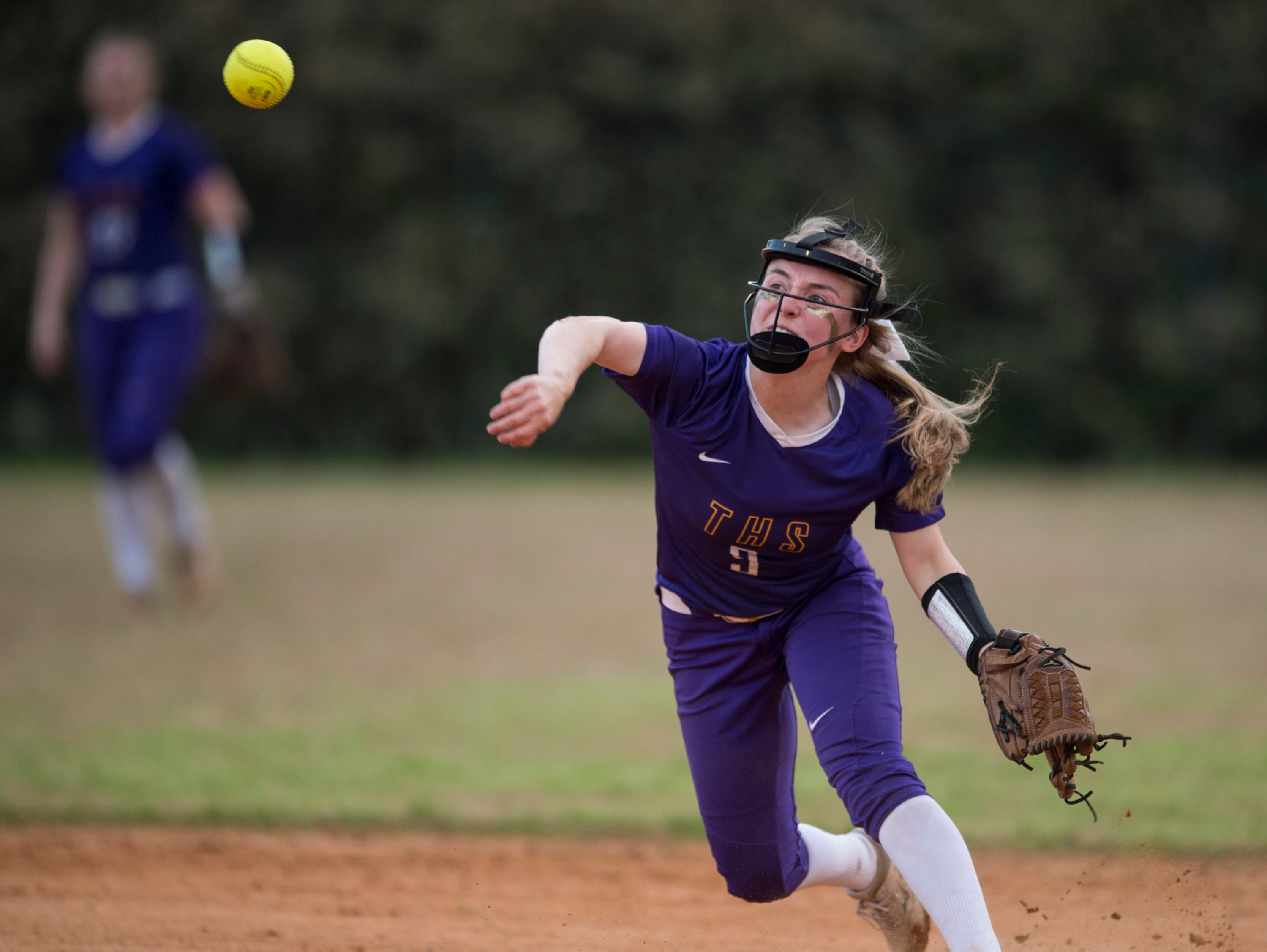 Tallassee's Alivia Haynes (9) throws the ball to first base at Thompson Park in Montgomery, Ala., on Thursday, March 14, 2019. Tallassee defeated Brew Tech 7-0.