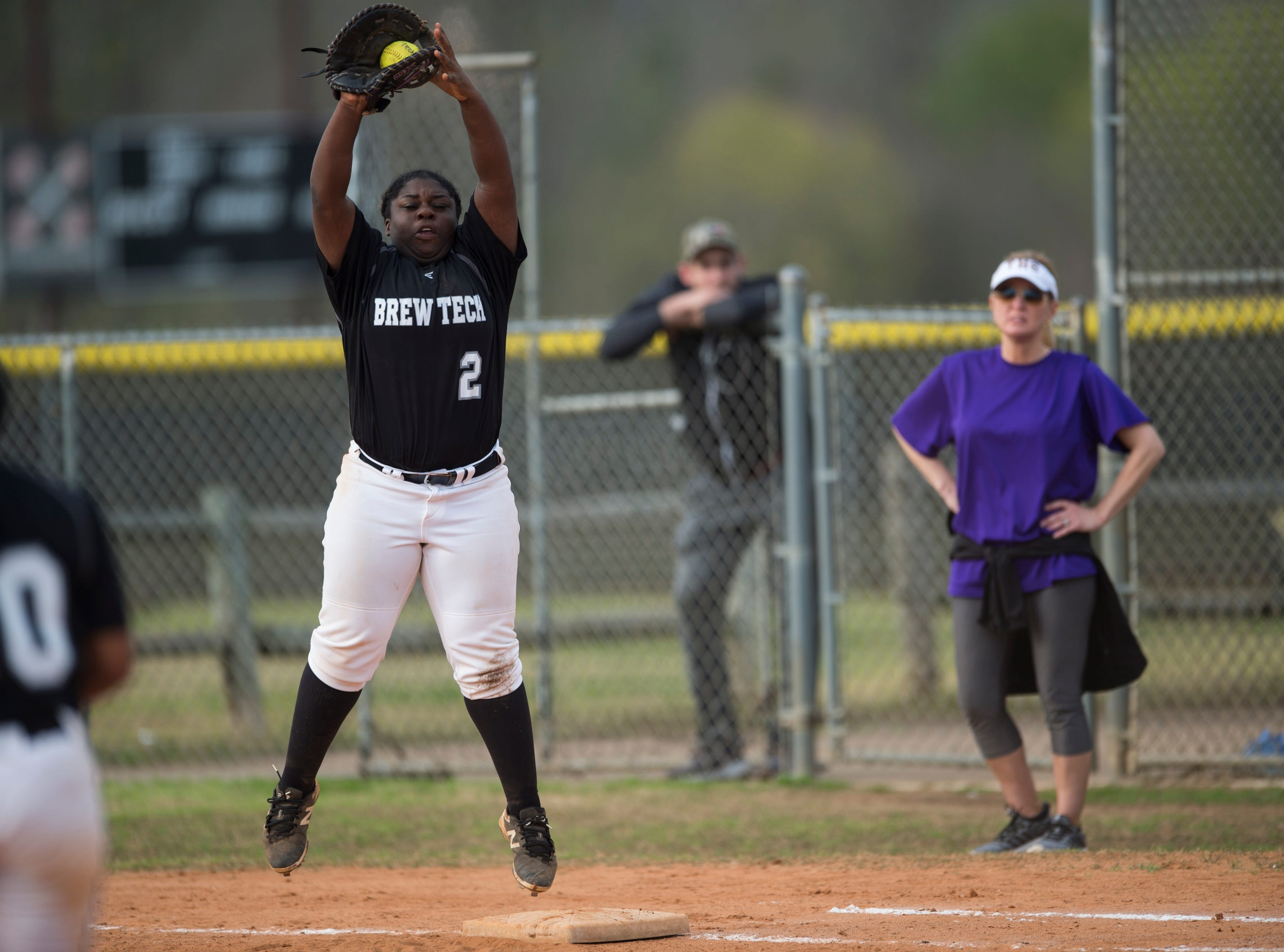 Brew Tech's Brittany Key (2) catches the ball at first base at Thompson Park in Montgomery, Ala., on Thursday, March 14, 2019. Tallassee defeated Brew Tech 7-0.