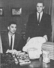 Morris Dees, right, and Millard Fuller with their direct-mail sales products. The two ran a number of enterprising businesses in Tuscaloosa as law students and later in Montgomery. Fuller would go on to found Habitat for Humanity.