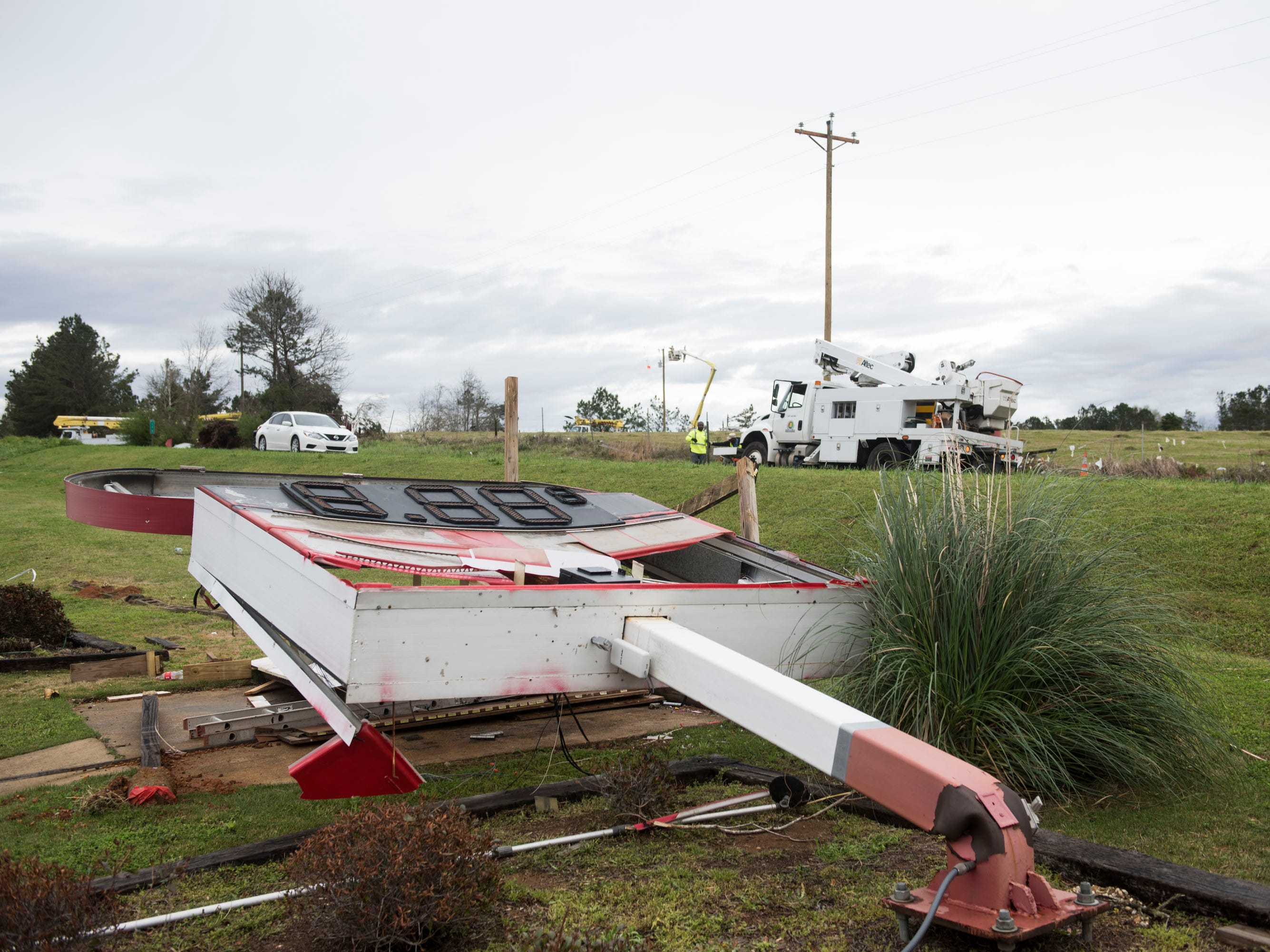 The sign at Kim's Korner gas station is toppled over after a Tornado hit in Titus, Ala., on Friday, March 15, 2019.