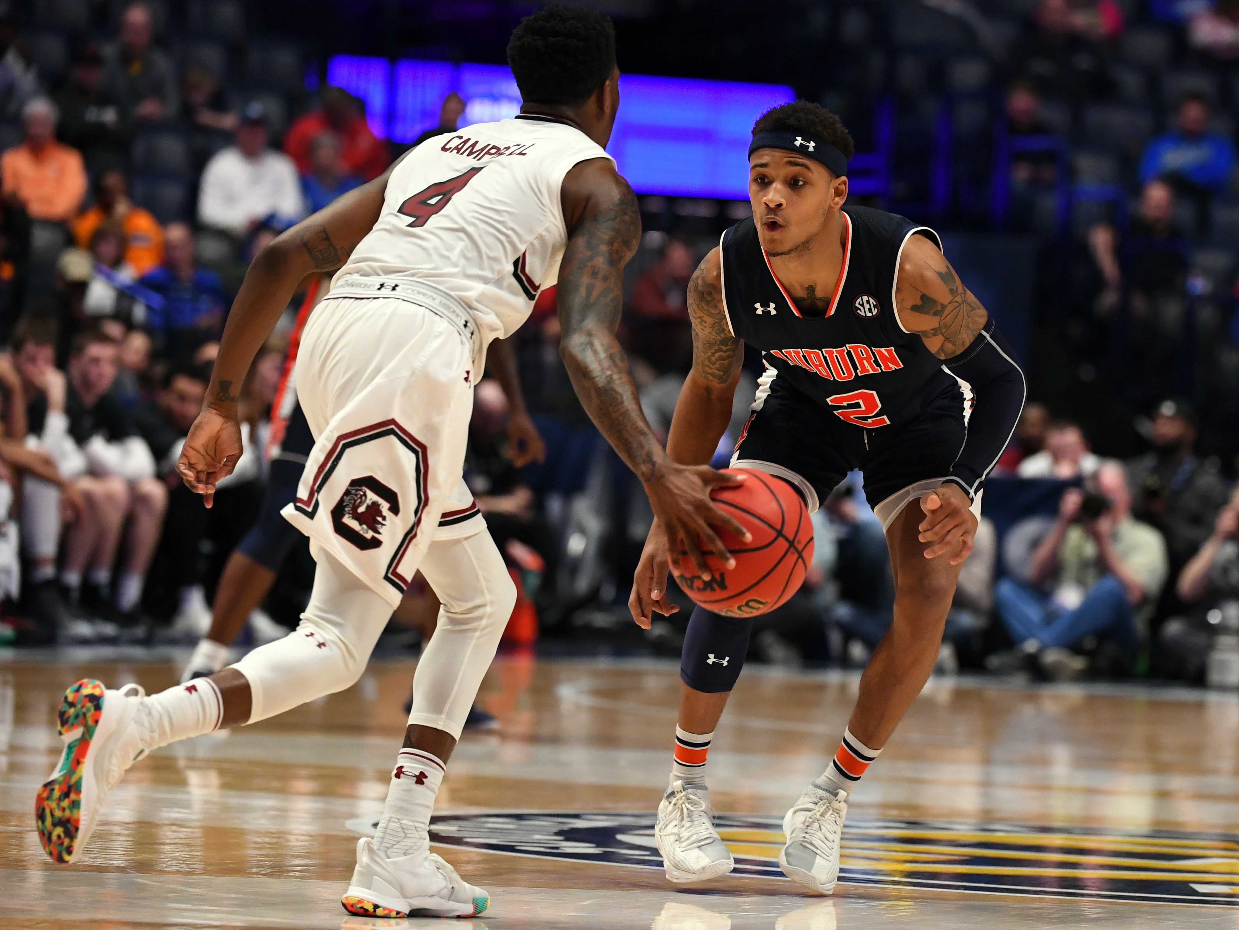 Mar 15, 2019; Nashville, TN, USA; South Carolina Gamecocks guard Tre Campbell (4) is defended by Auburn Tigers guard Bryce Brown (2) during the second half of the SEC conference tournament at Bridgestone Arena. Mandatory Credit: Christopher Hanewinckel-USA TODAY Sports
