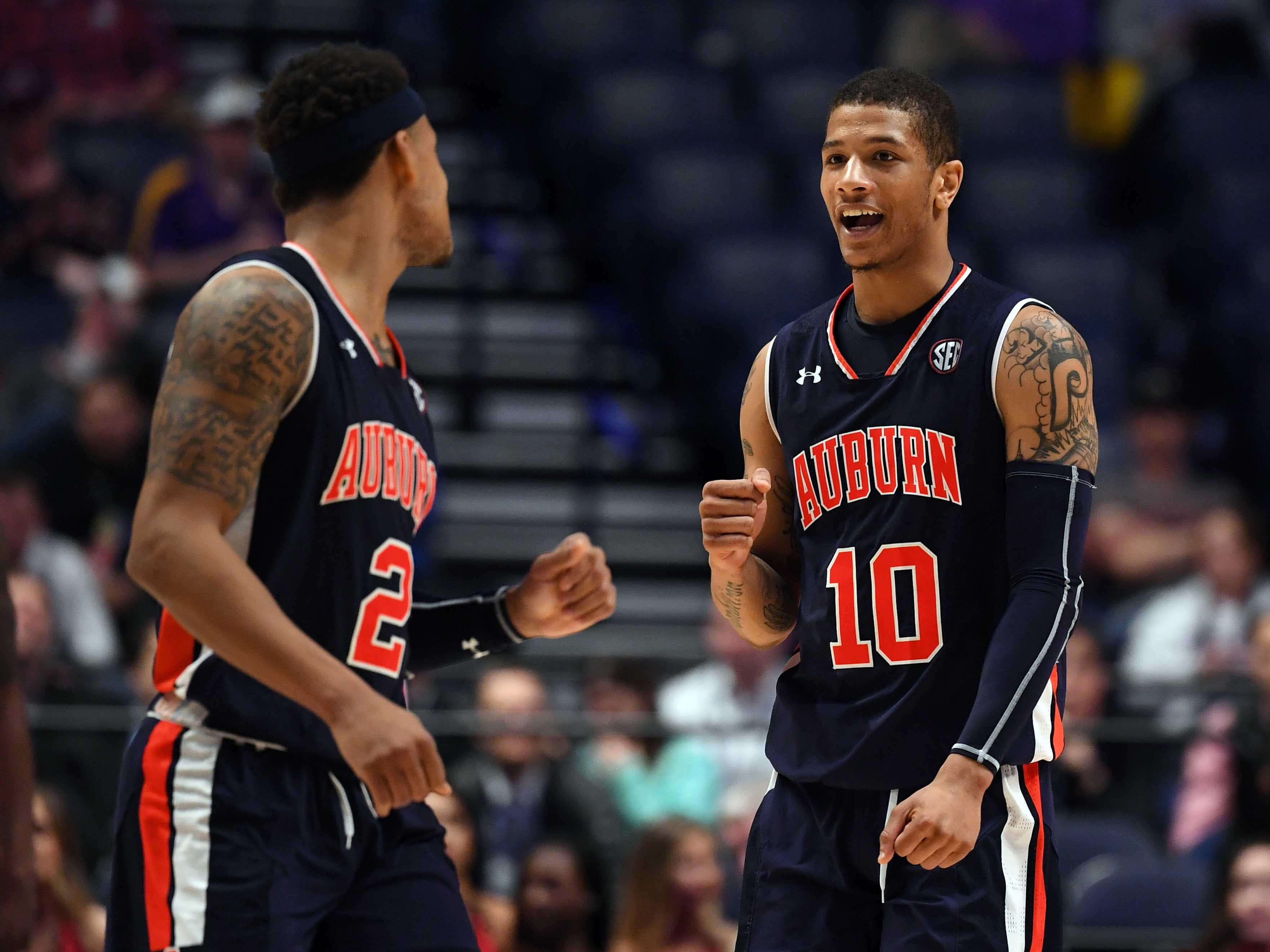Mar 15, 2019; Nashville, TN, USA; Auburn Tigers guard Samir Doughty (10) and Auburn Tigers guard Bryce Brown (2) celebrate during the second half against the South Carolina Gamecocks in the SEC conference tournament at Bridgestone Arena. Mandatory Credit: Christopher Hanewinckel-USA TODAY Sports