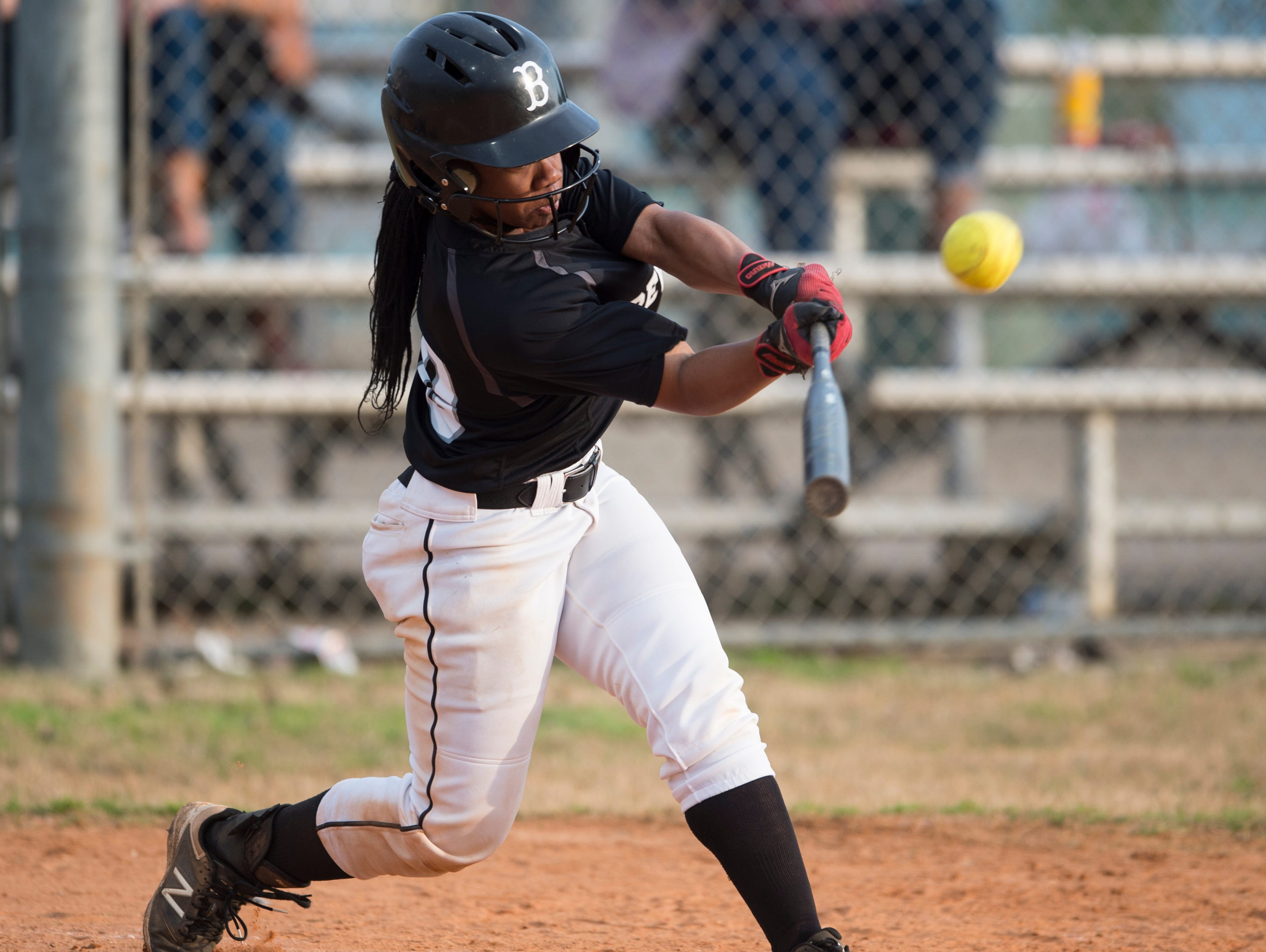 Brew Tech's Tyra Johnson (00) swings at the ball at Thompson Park in Montgomery, Ala., on Thursday, March 14, 2019. Tallassee defeated Brew Tech 7-0.