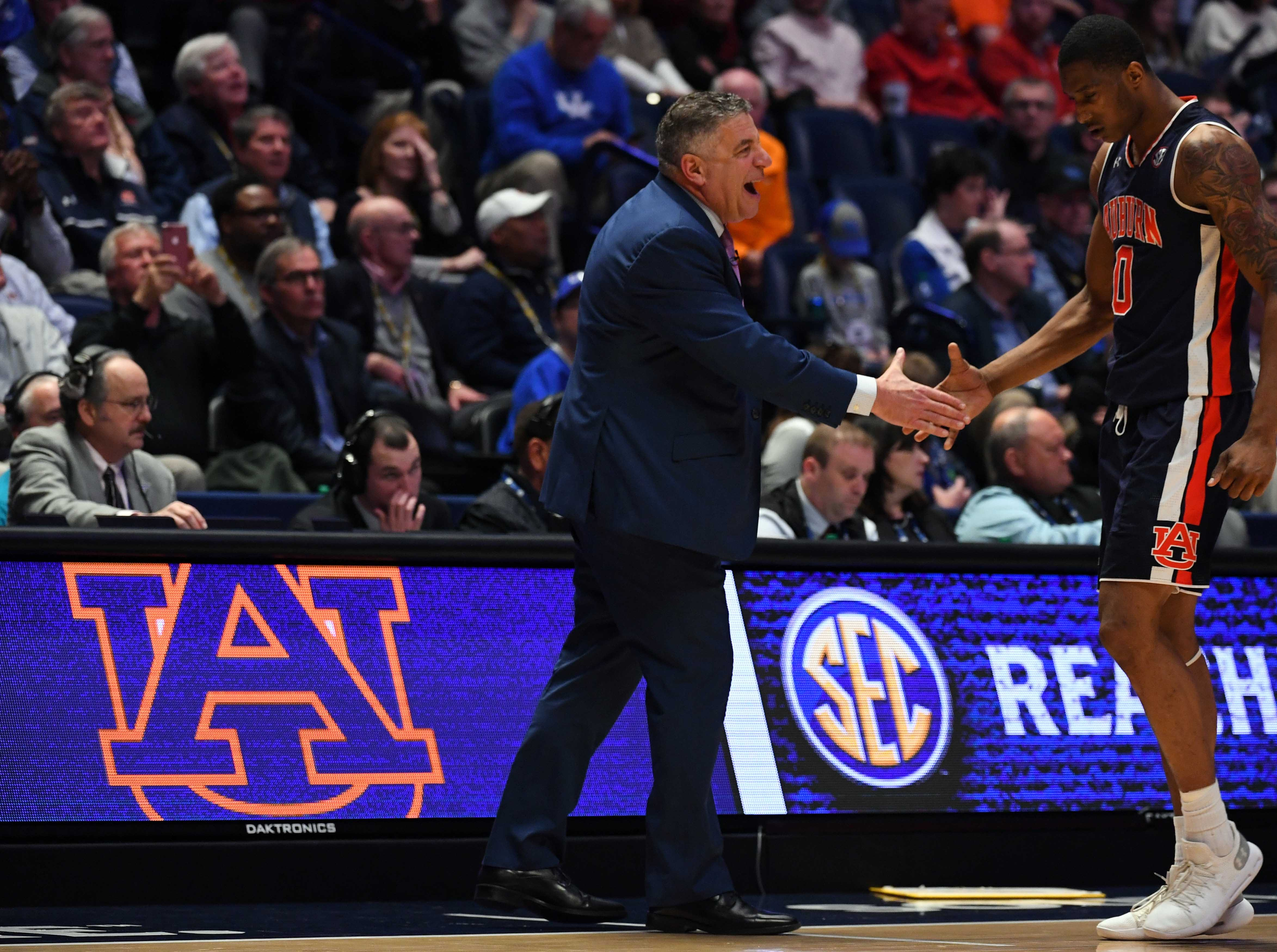 Auburn head coach Bruce Pearl and center Horace Spencer (0) during the second half against South Carolina at the SEC Tournament on March 15, 2019, in Nashville, Tennessee.
