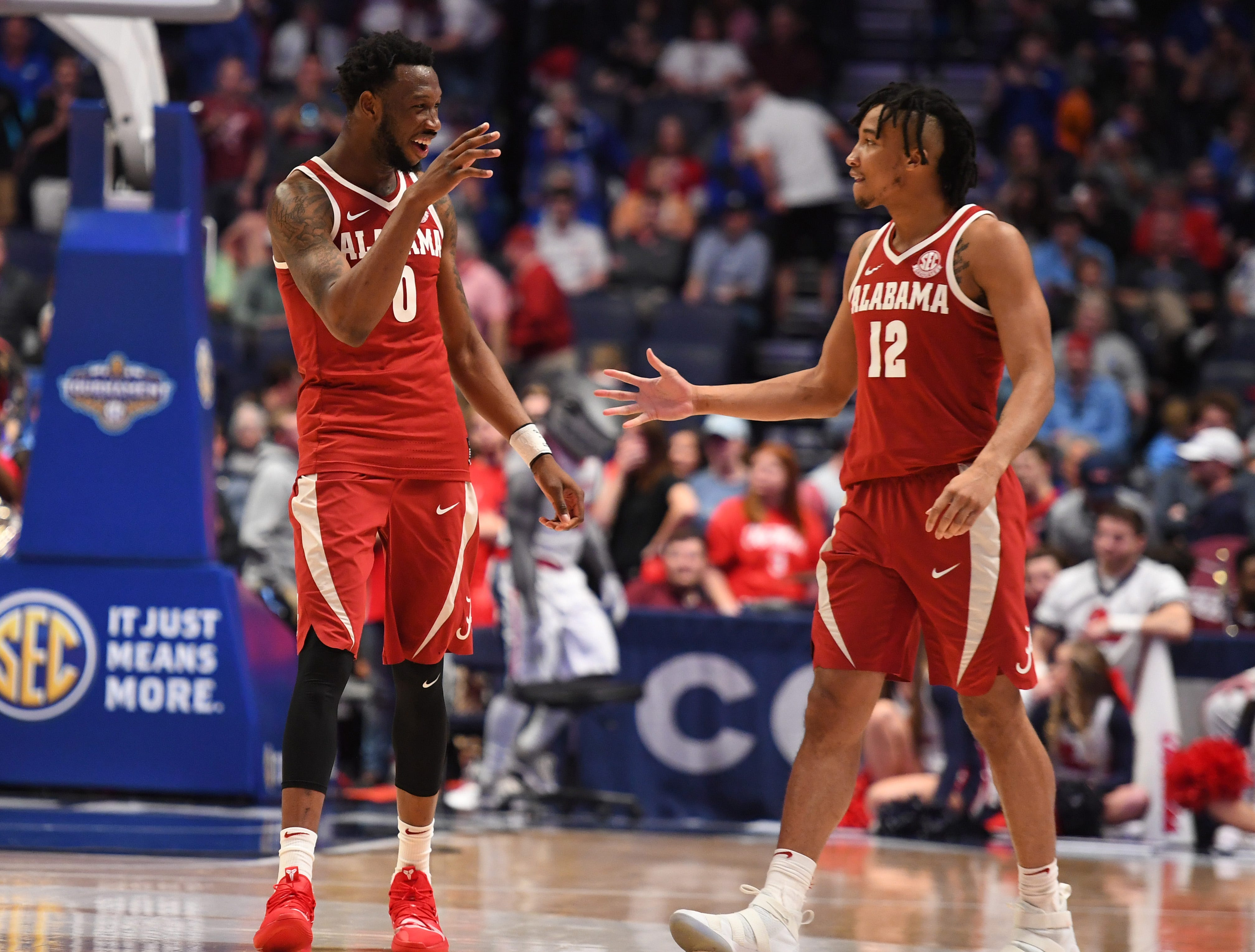 Mar 14, 2019; Nashville, TN, USA; Alabama Crimson Tide forward Donta Hall (0) and Alabama Crimson Tide guard Dazon Ingram (12)celebrate after a win against the Mississippi Rebels in the SEC conference tournament at Bridgestone Arena. Mandatory Credit: Christopher Hanewinckel-USA TODAY Sports