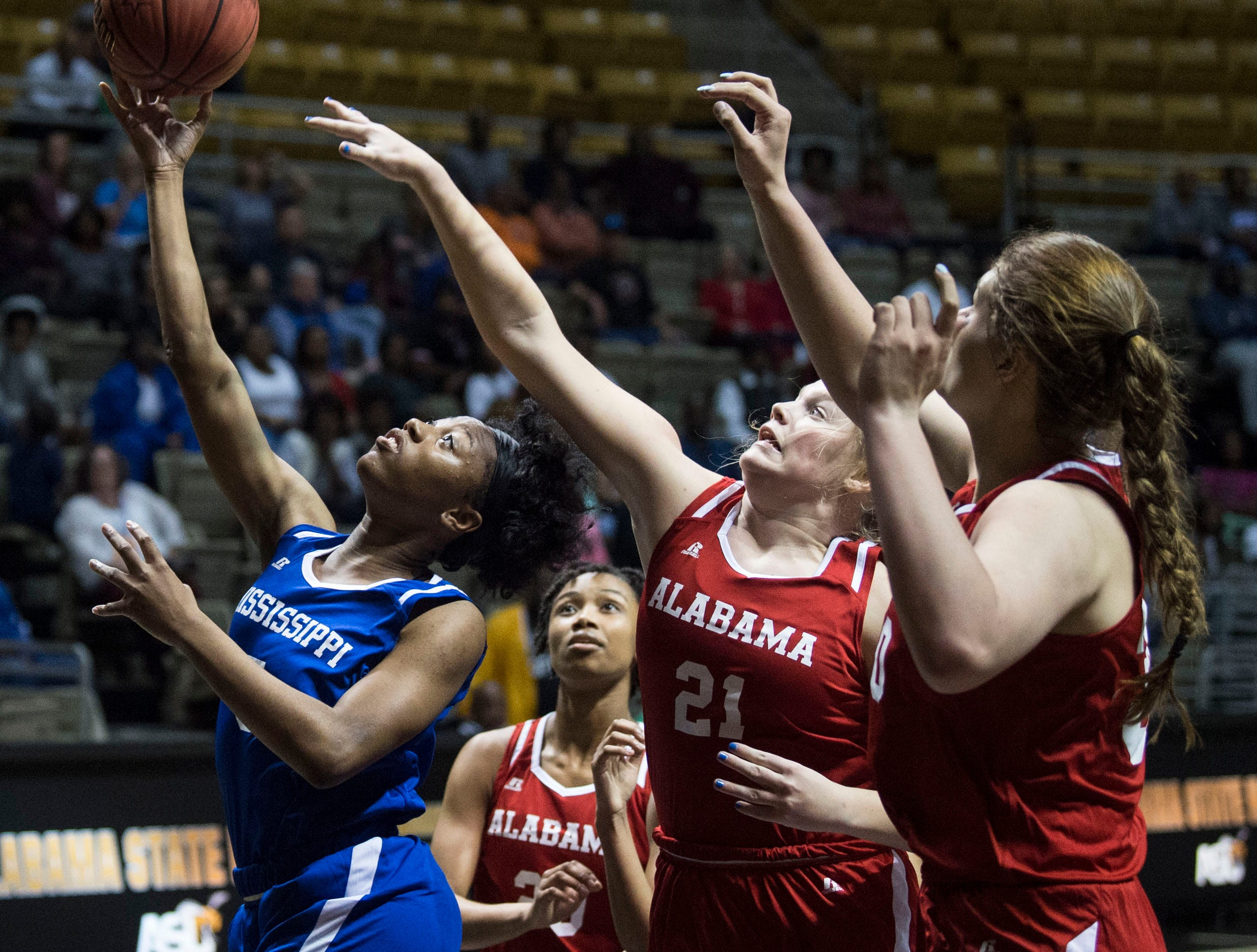 Mississippi's Ebony Gayden (5) goes up for a layup during the Alabama-Mississippi All-Star game at the Dunn-Oliver Acadome in Montgomery, Ala., on Friday, March 15, 2019. Alabama All-stars lead the Mississippi All-stars 48-34 at halftime.