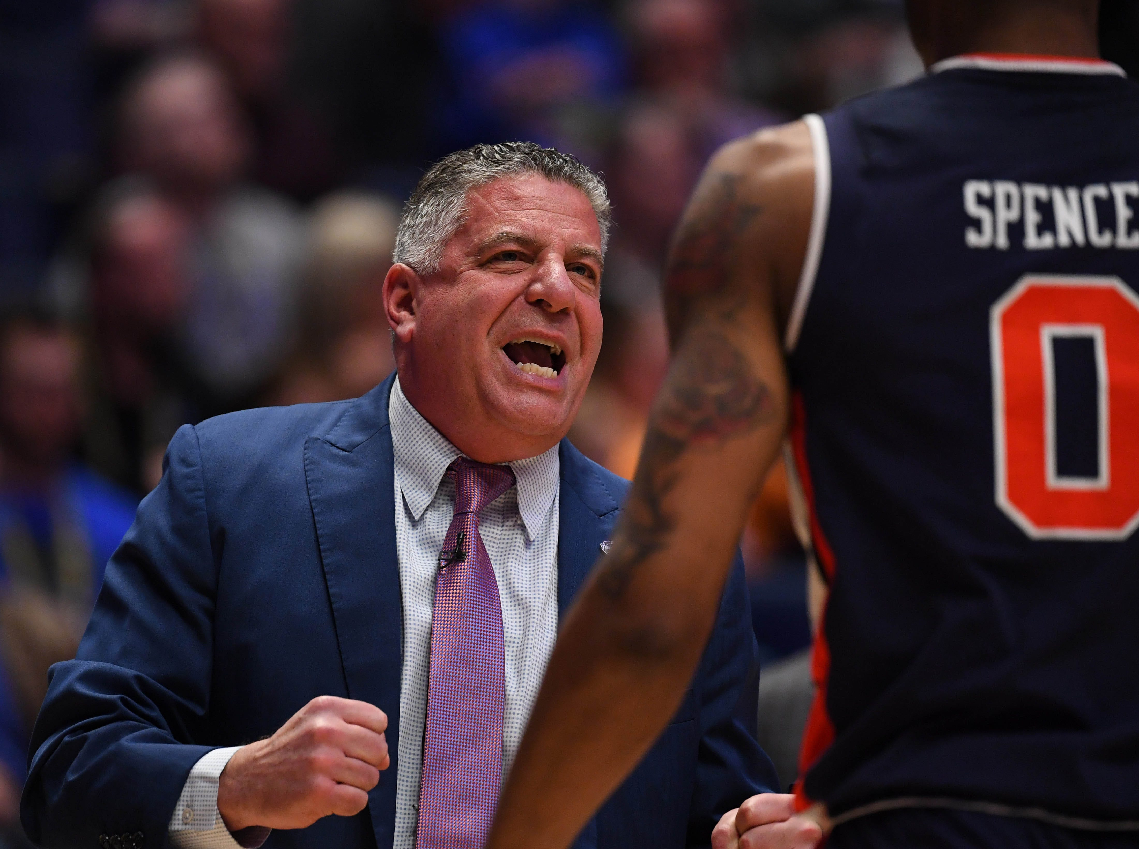 Mar 15, 2019; Nashville, TN, USA; Auburn Tigers head coach Bruce Pearl (left) talks with Auburn Tigers forward Horace Spencer (0) against the South Carolina Gamecocks during the first half of the SEC conference tournament at Bridgestone Arena. Mandatory Credit: Christopher Hanewinckel-USA TODAY Sports