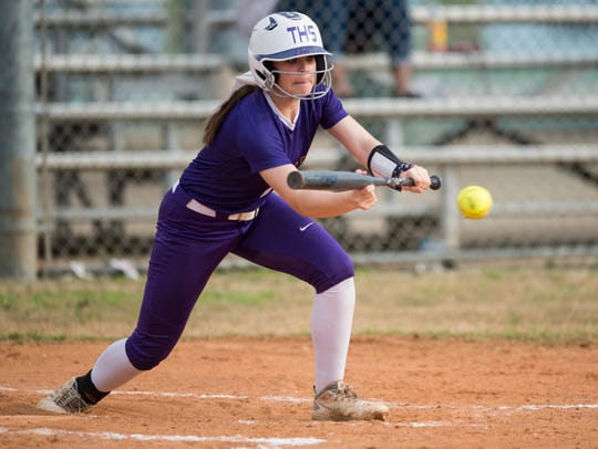 Tallassee's Alexis Love (2) attempts a bunt at Thompson Park in Montgomery, Ala., on Thursday, March 14, 2019. Tallassee defeated Brew Tech 7-0.