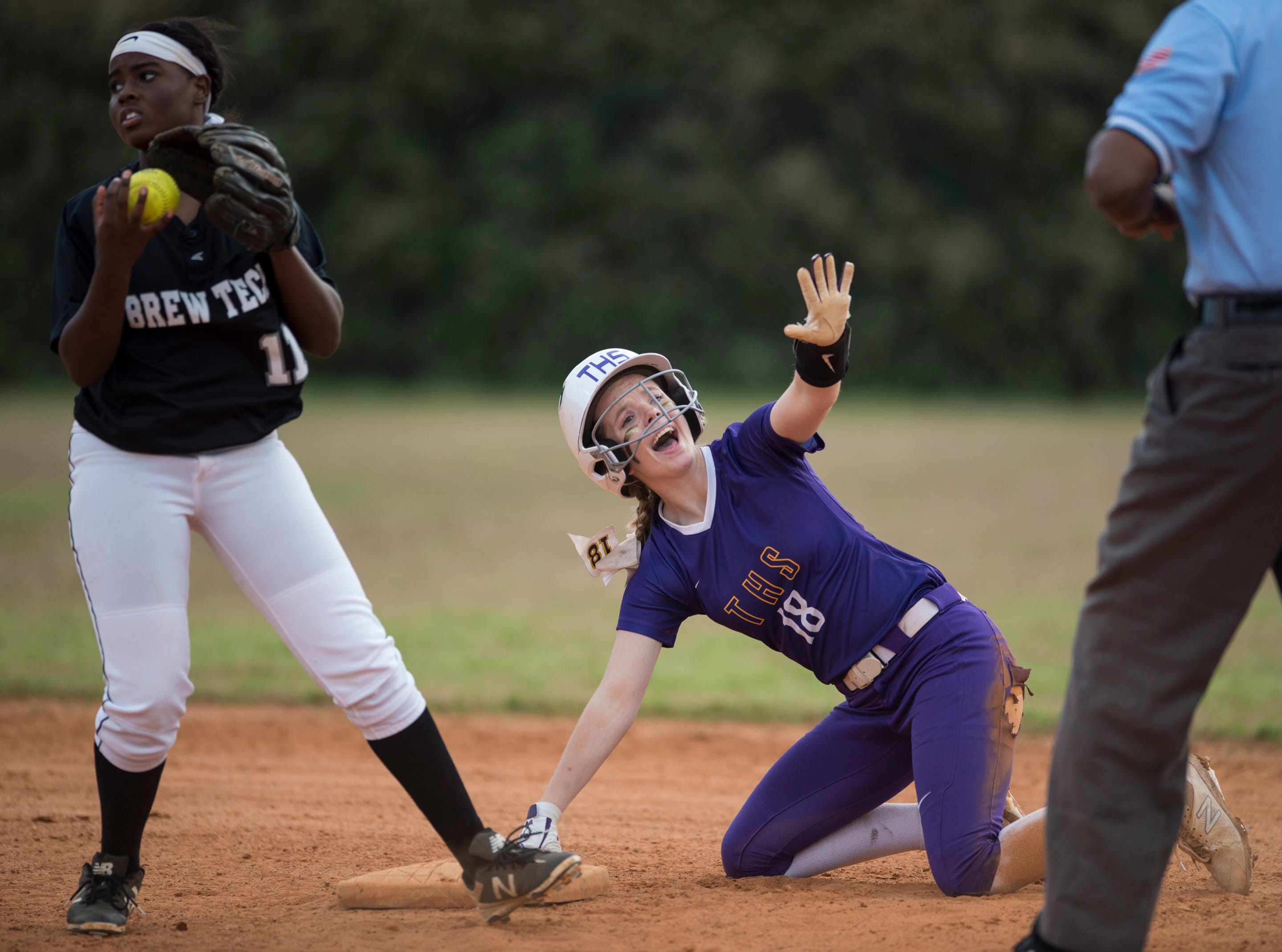 Tallassee's Chloe Baynes (18) asks for a pause after making it safely to second base at Thompson Park in Montgomery, Ala., on Thursday, March 14, 2019. Tallassee defeated Brew Tech 7-0.