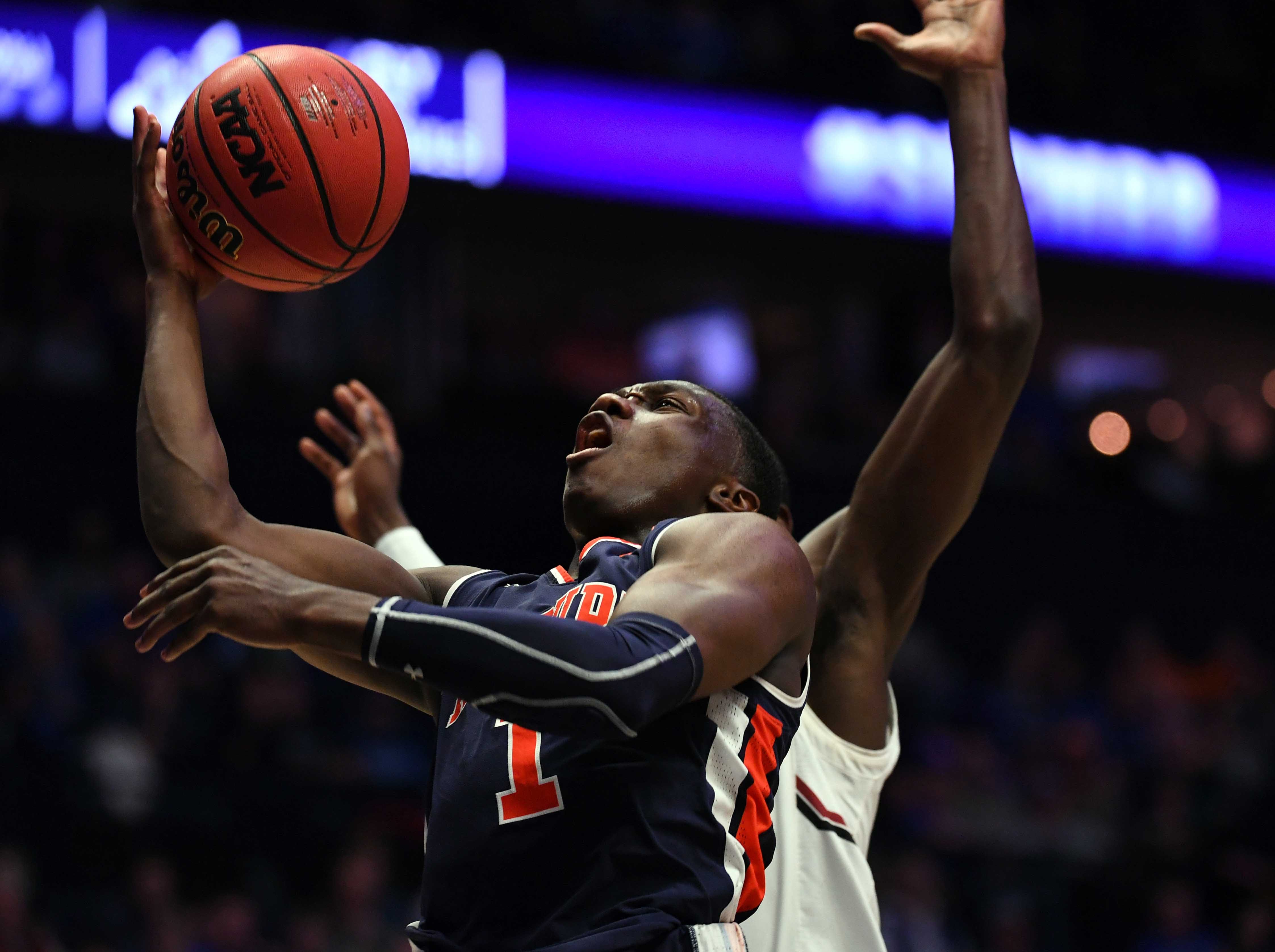 Mar 15, 2019; Nashville, TN, USA; Auburn Tigers guard Jared Harper (1) is fouled as he tries a layup during the second half against the South Carolina Gamecocks in the SEC conference tournament at Bridgestone Arena. Mandatory Credit: Christopher Hanewinckel-USA TODAY Sports