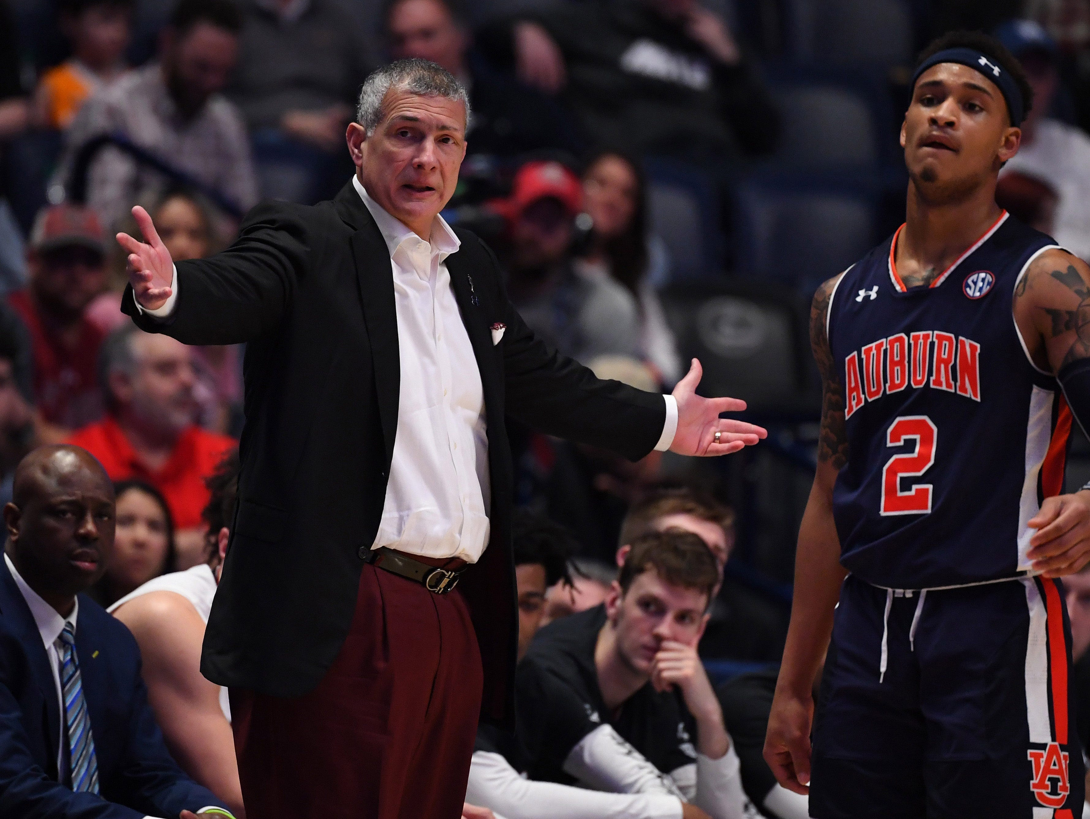Mar 15, 2019; Nashville, TN, USA; South Carolina Gamecocks head coach Frank Martin (left) questions a call against the Auburn Tigers during the first half of the SEC conference tournament at Bridgestone Arena. Mandatory Credit: Christopher Hanewinckel-USA TODAY Sports
