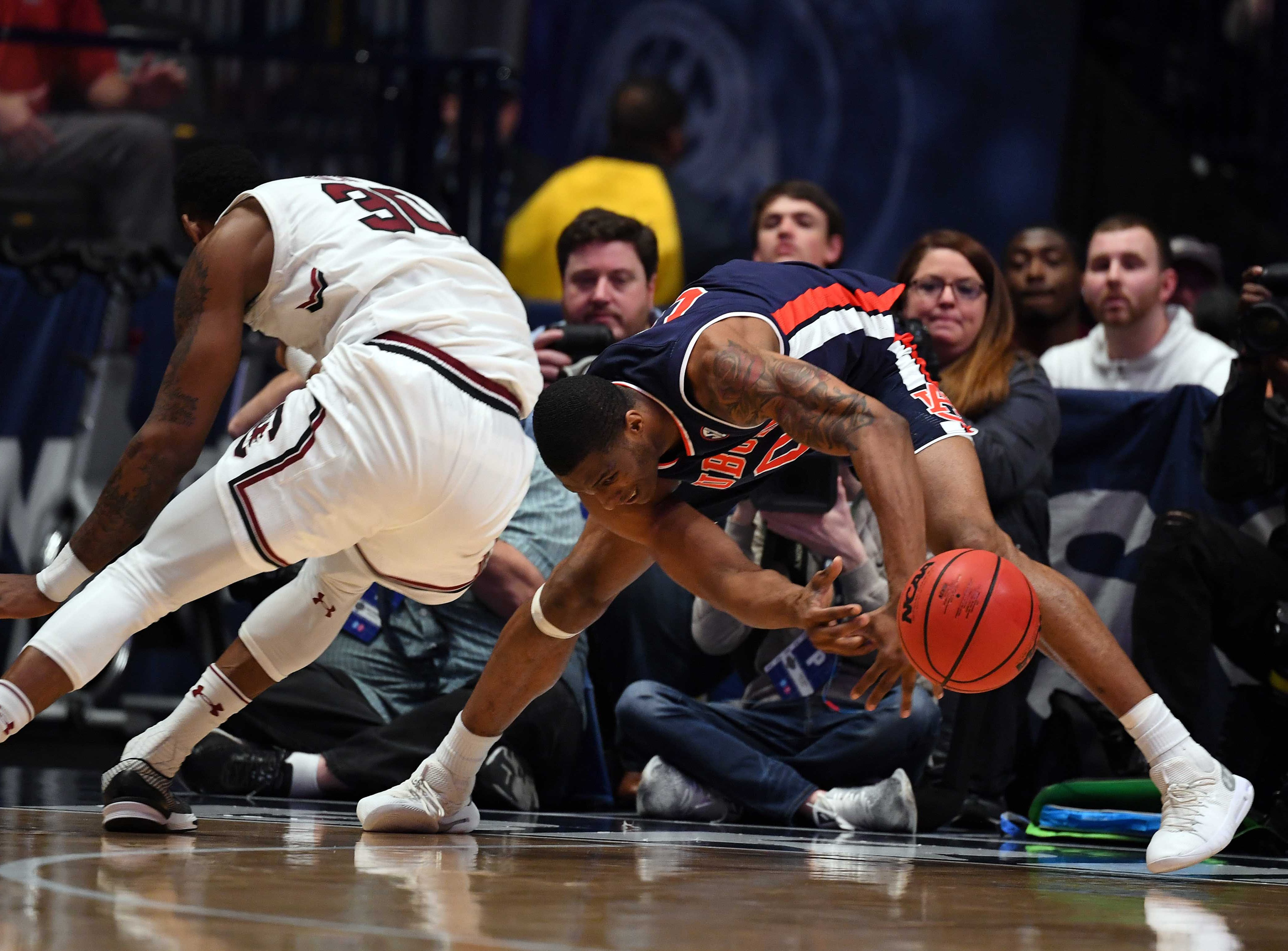 Mar 15, 2019; Nashville, TN, USA; South Carolina Gamecocks forward Chris Silva (30) and Auburn Tigers forward Horace Spencer (0) battle for a loose ball in the corner during the first half of the SEC conference tournament at Bridgestone Arena. Mandatory Credit: Christopher Hanewinckel-USA TODAY Sports