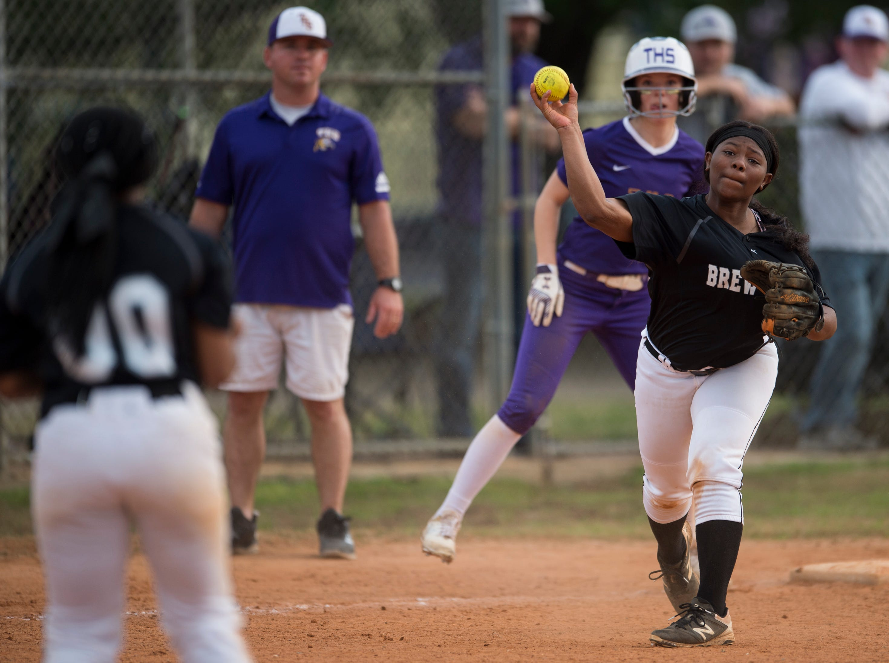 Brew Tech's Janeen White (1) throws to first base from third base at Thompson Park in Montgomery, Ala., on Thursday, March 14, 2019. Tallassee defeated Brew Tech 7-0.