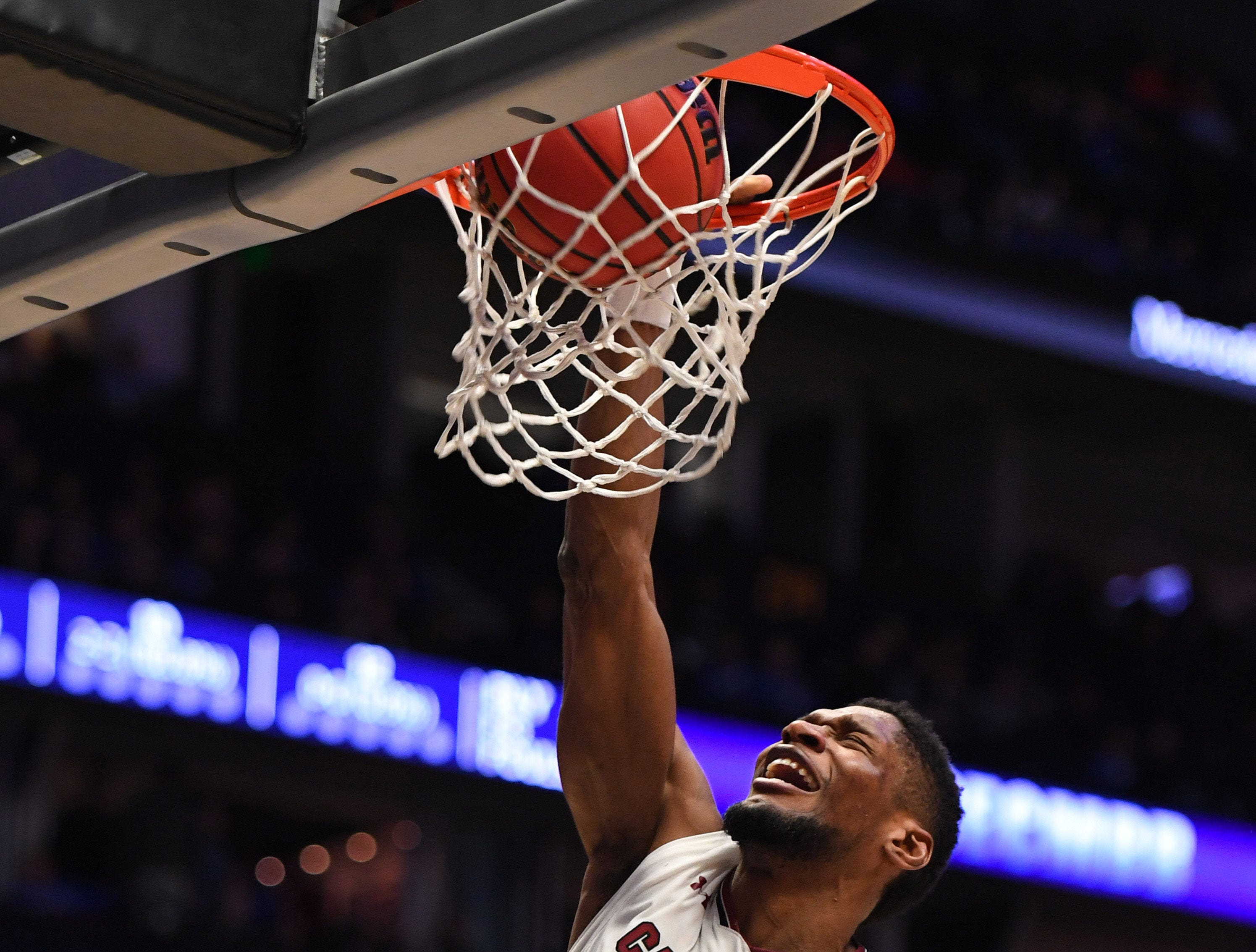 Mar 15, 2019; Nashville, TN, USA; South Carolina Gamecocks forward Chris Silva (30) dunks the ball against the Auburn Tigers during the first half of the SEC conference tournament at Bridgestone Arena. Mandatory Credit: Christopher Hanewinckel-USA TODAY Sports