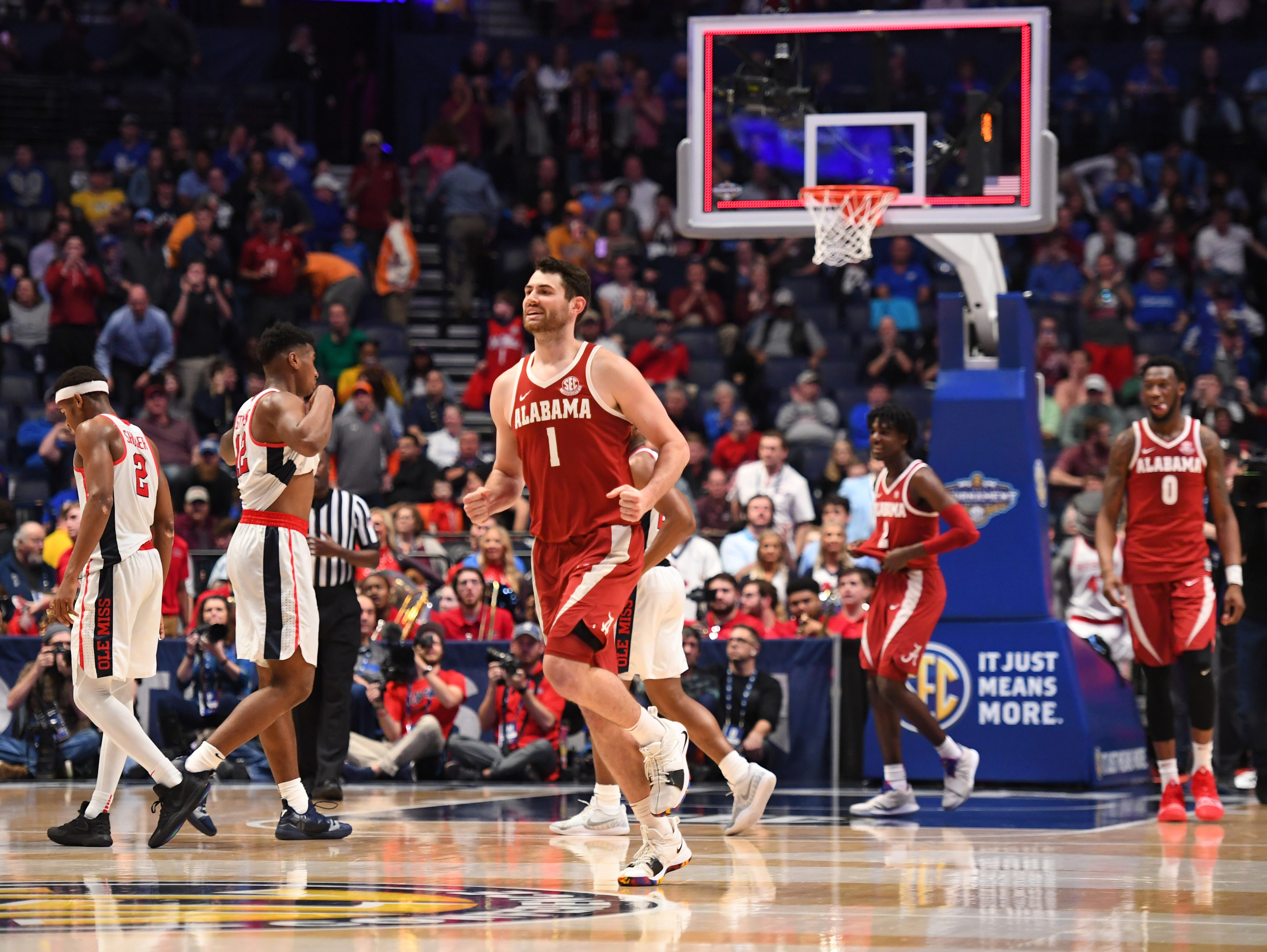 Mar 14, 2019; Nashville, TN, USA; Alabama Crimson Tide guard Riley Norris (1) celebrates after a win against the Mississippi Rebels in the SEC conference tournament at Bridgestone Arena. Mandatory Credit: Christopher Hanewinckel-USA TODAY Sports