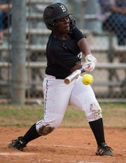 Brew Tech's A'miah Todd (4) swings at the ball at Thompson Park in Montgomery, Ala., on Thursday, March 14, 2019. Tallassee defeated Brew Tech 7-0.