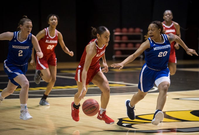 Alabama's Skyla Knight (1) drives the ball down the court defended by Mississippi's Jayla Alexander (20) during the Alabama-Mississippi All-Star game at the Dunn-Oliver Acadome in Montgomery, Ala., on Friday, March 15, 2019. Alabama All-stars lead the Mississippi All-stars 48-34 at halftime.