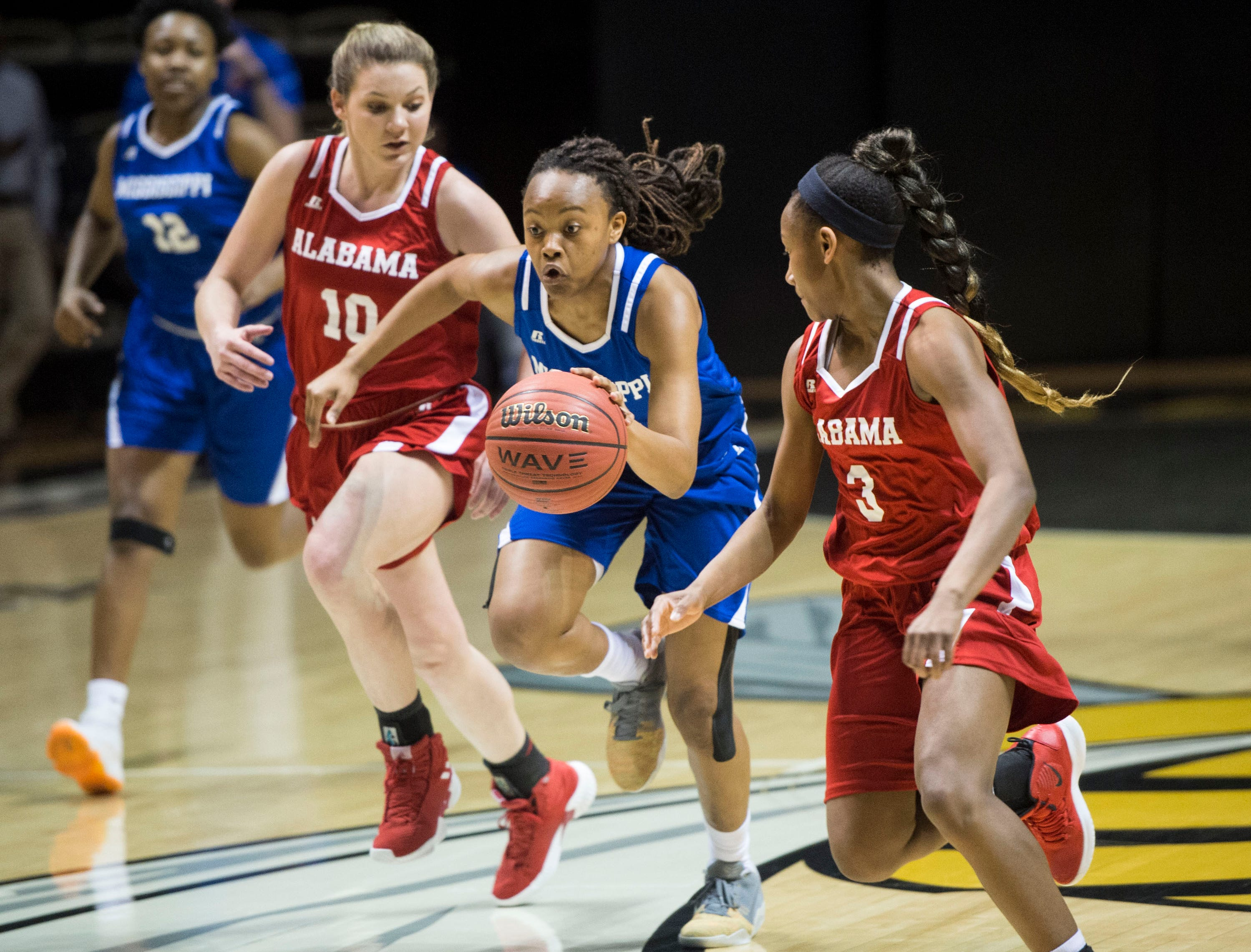 Mississippi's Jalisa Outlaw (11) drives the ball down the court during the Alabama-Mississippi All-Star game at the Dunn-Oliver Acadome in Montgomery, Ala., on Friday, March 15, 2019. Alabama All-stars lead the Mississippi All-stars 48-34 at halftime.