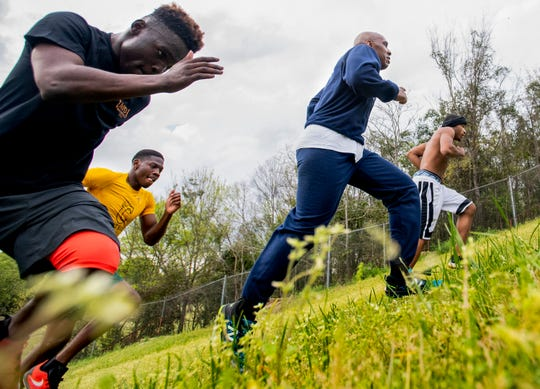 Montgomery Police Lt. John Mackey runs hills with his boxing students at the McIntyre Community Center in Montgomery, Ala., on Thursday March 14, 2019.