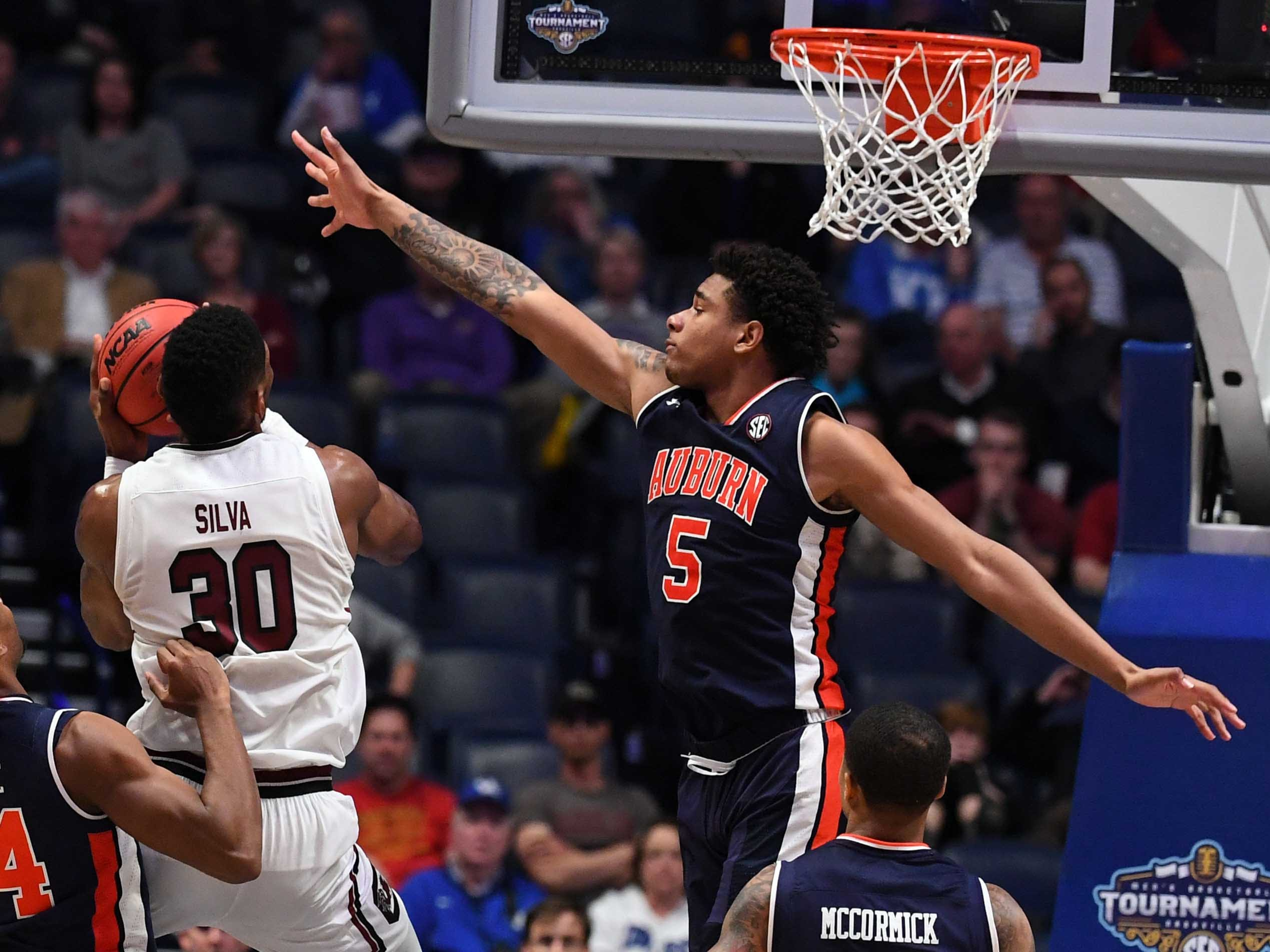 Auburn forward Chuma Okeke (5) defends South Carolina forward Chris Silva (30) during the SEC Tournament on March 15, 2019, in Nashville, Tennessee.