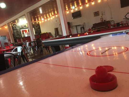 Air hockey and pool tables wait stand inside That's My Dog Jr. After school each day, the restaurant will turn into a safe space for teens.