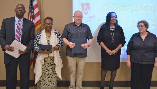 Dora Fenderson and Ron Olszewski, holding certificates, were named the Montgomery Public Schools Employees of the Month for March 2019. They are shown with MPS Chief Financial Officer Arthur Watts, left, Superintendent Ann Roy Moore, second from rightand Board President Clare Weil.