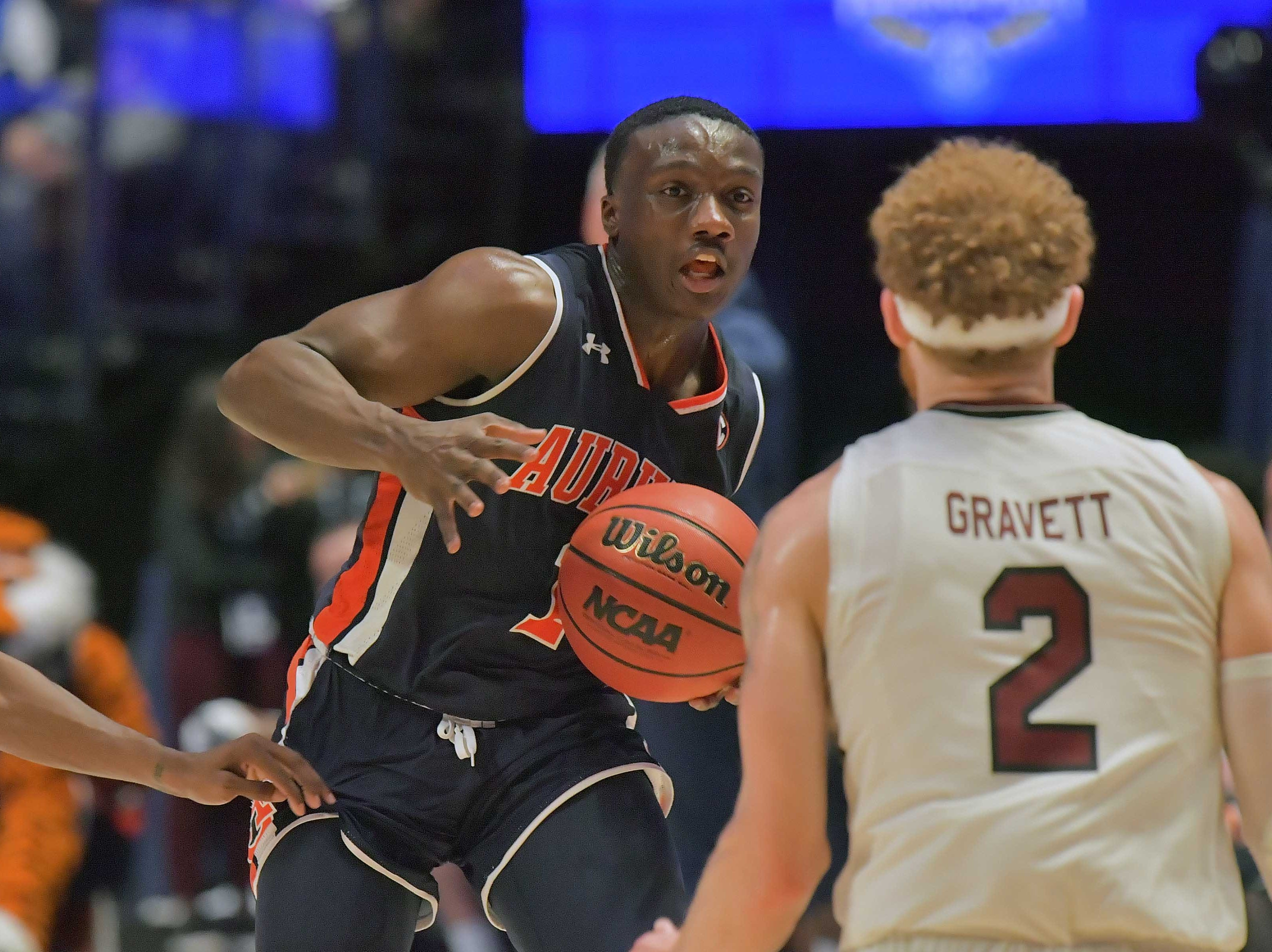 Mar 15, 2019; Nashville, TN, USA; Auburn Tigers guard Jared Harper (1) drives against South Carolina Gamecocks guard Hassani Gravett (2) during the first half of game eight in the SEC conference tournament at Bridgestone Arena. Mandatory Credit: Jim Brown-USA TODAY Sports