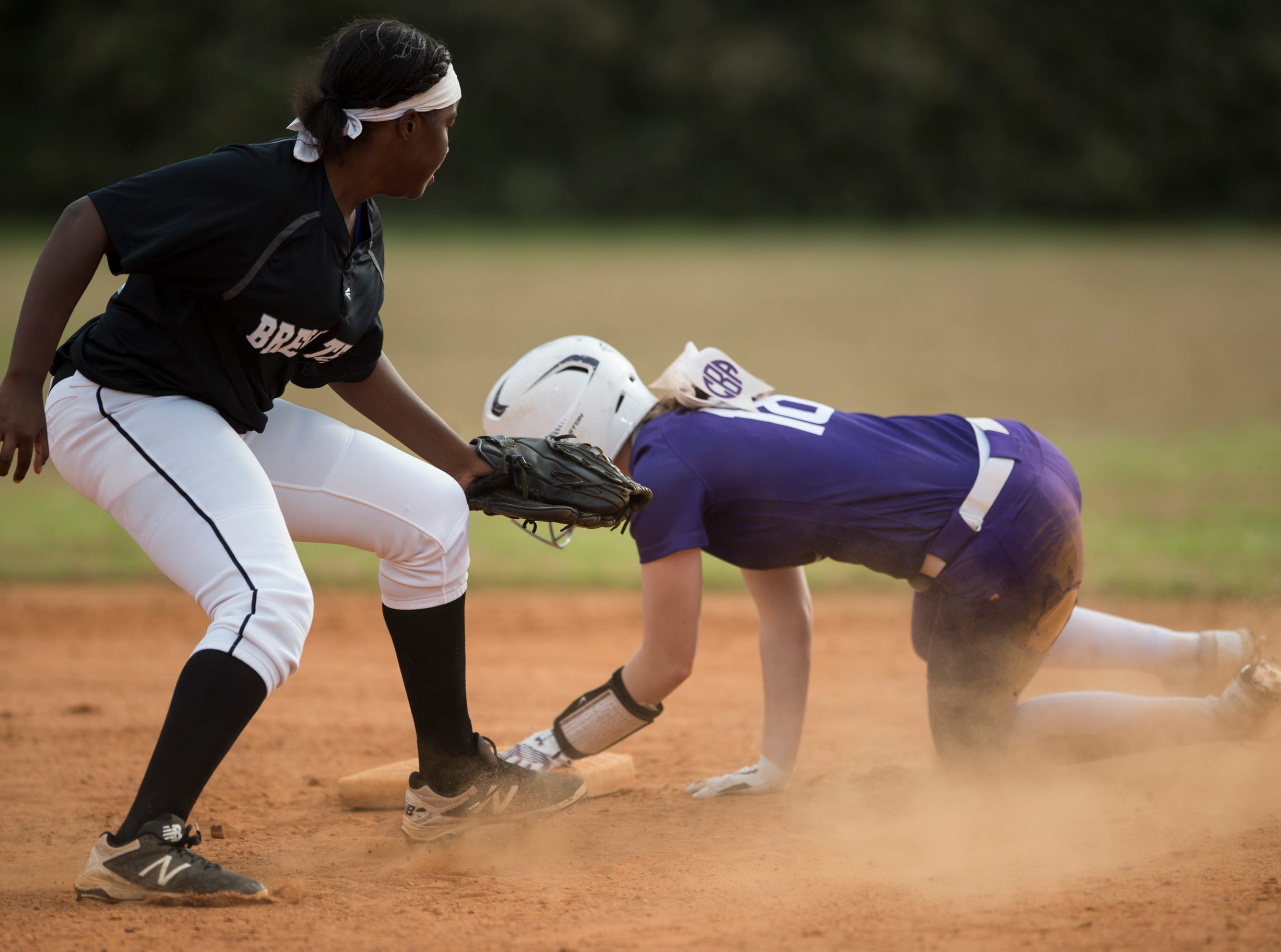 Tallassee's Chloe Baynes (18) slides safely into second base past Brew Tech's Mackenzie Wilson (11) at Thompson Park in Montgomery, Ala., on Thursday, March 14, 2019. Tallassee defeated Brew Tech 7-0.