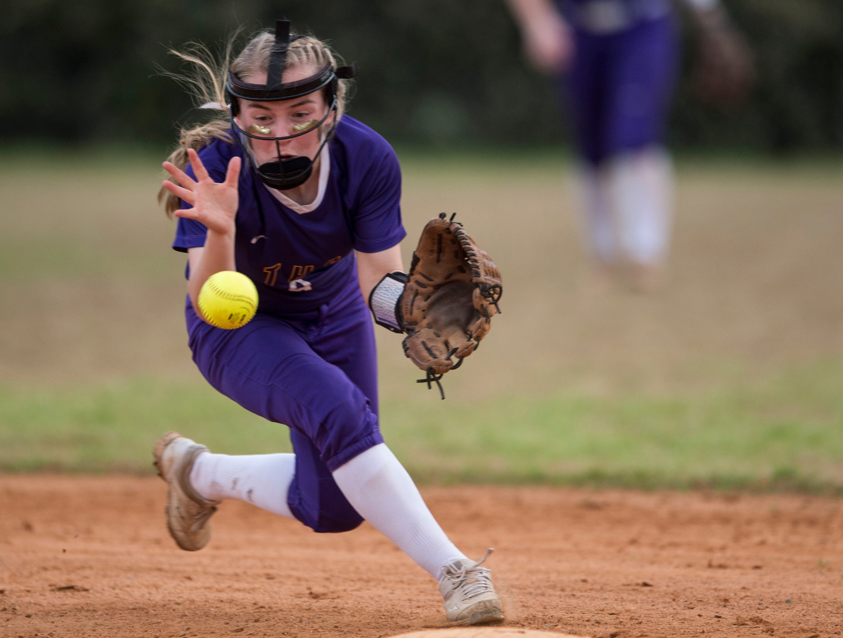 Tallassee's Alivia Haynes (9) fields the ball near second base at Thompson Park in Montgomery, Ala., on Thursday, March 14, 2019. Tallassee defeated Brew Tech 7-0.