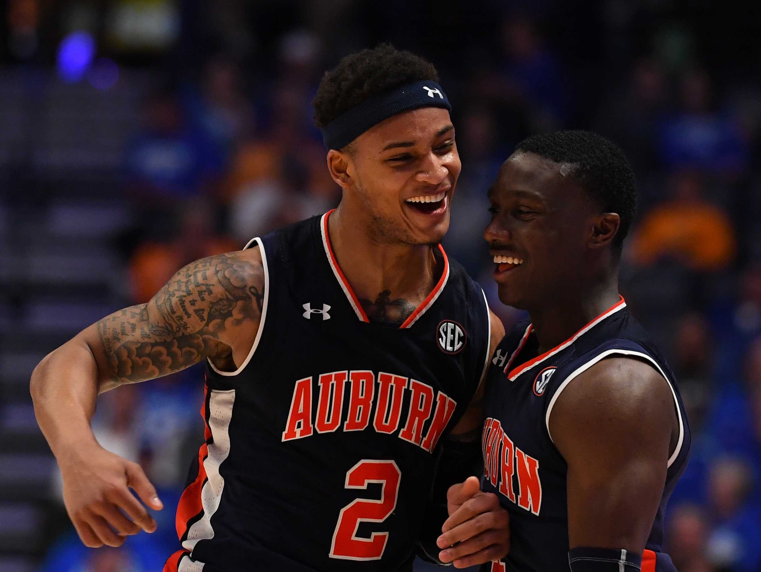 Mar 15, 2019; Nashville, TN, USA; Auburn Tigers guard Jared Harper (1) and Auburn Tigers guard Bryce Brown (2) celebrate after a basket against the South Carolina Gamecocks during the first half of the SEC conference tournament at Bridgestone Arena. Mandatory Credit: Christopher Hanewinckel-USA TODAY Sports