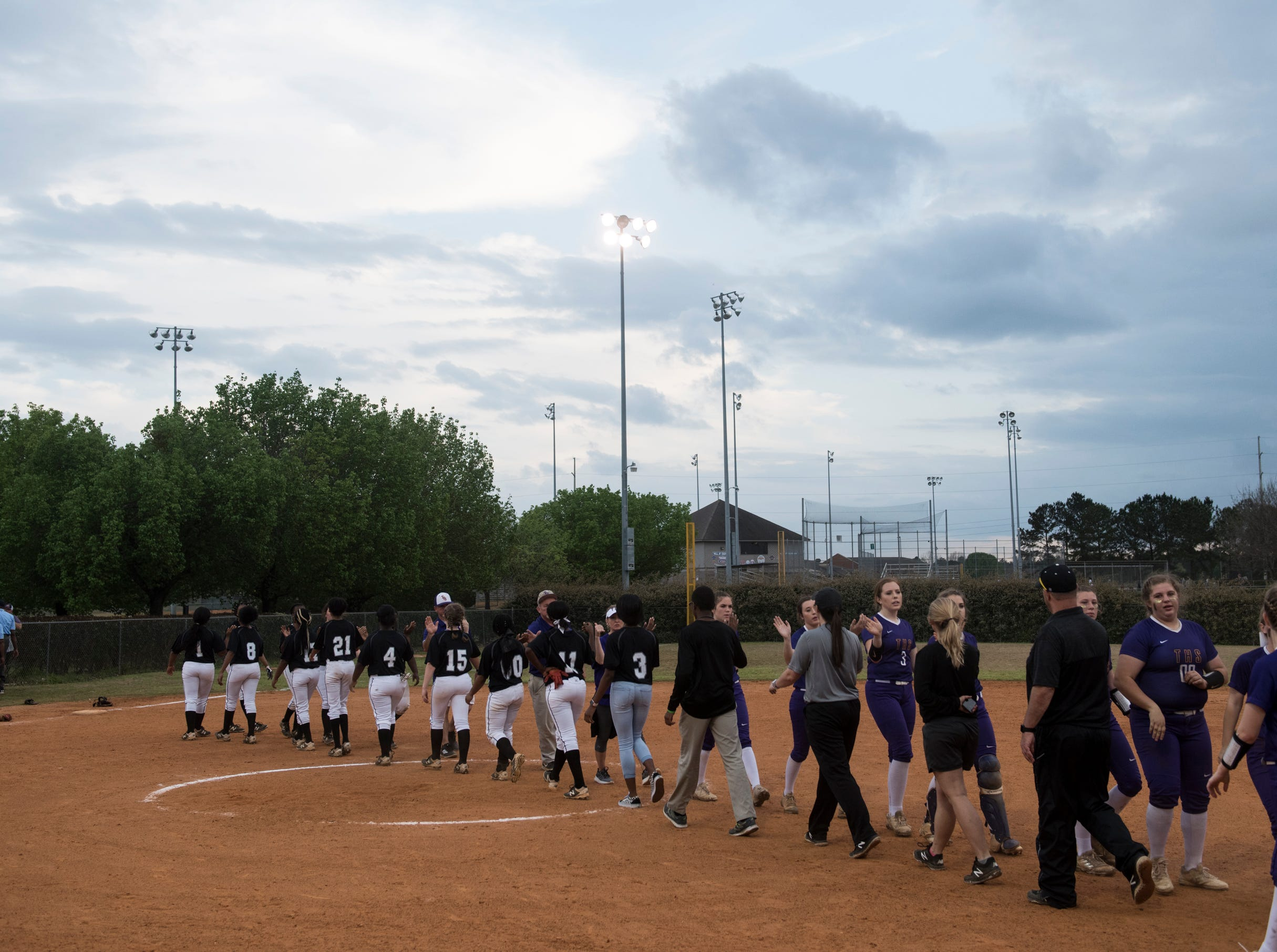 Brew Tech and Tallassee shake hands after the game at Thompson Park in Montgomery, Ala., on Thursday, March 14, 2019. Tallassee defeated Brew Tech 7-0.