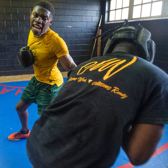 Javez Poole works out with his boxing club at the McIntyre Community Center in Montgomery, Ala., on Thursday March 14, 2019.